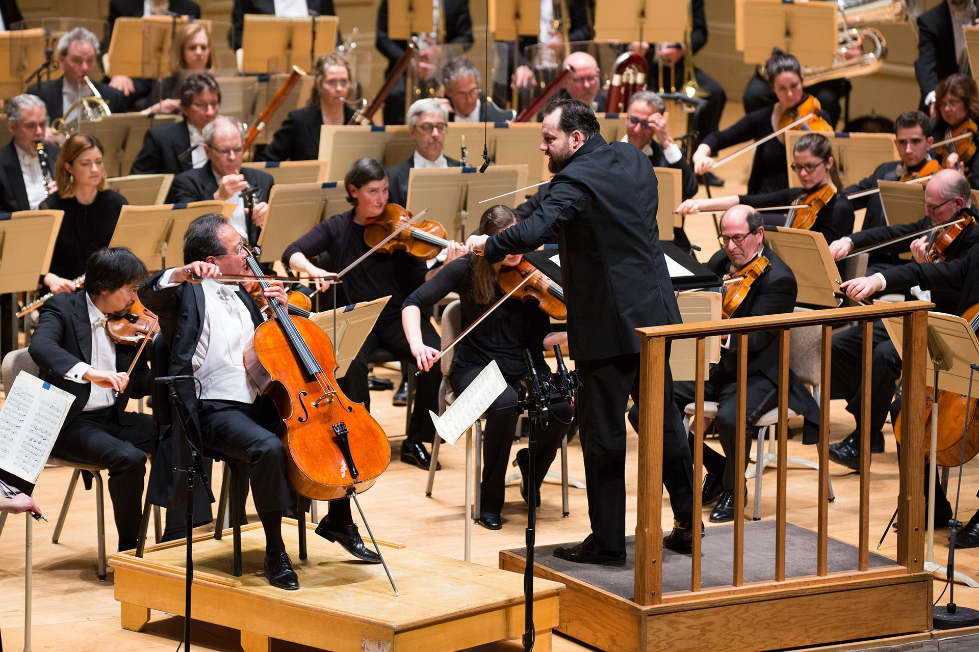 The Boston Symphony Orchestra, Andris Nelsons conducting, with soloists Yo-Yo Ma (left) and Steven Ansell (right of Nelsons), Thursday, March 29 at Symphony Hall. Robert Torres photograph