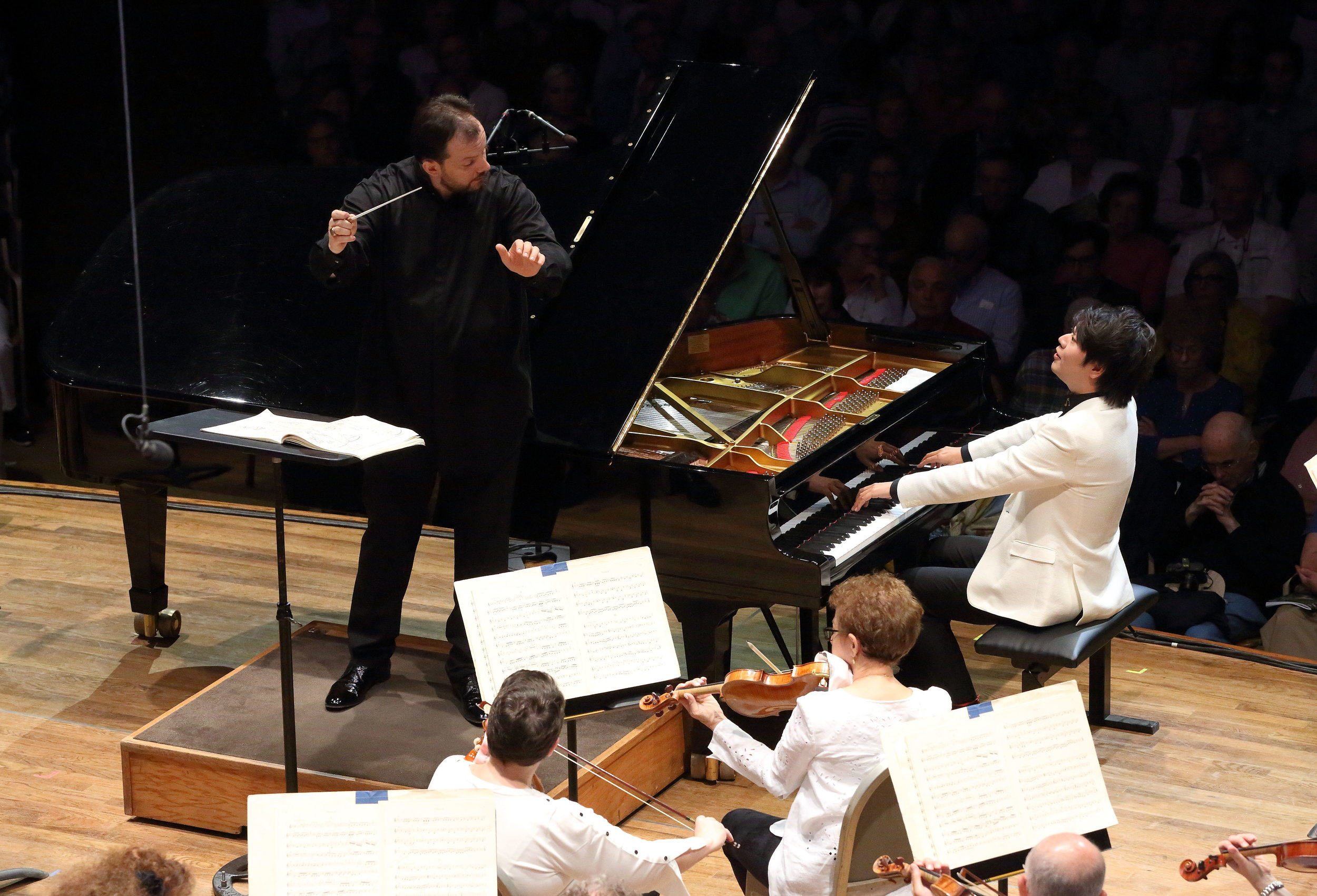Andris Nelsons checks in with soloist Lang Lang. At the Tanglewood opening night concert, July 7, in the Shed. Hilary Scott photograph.