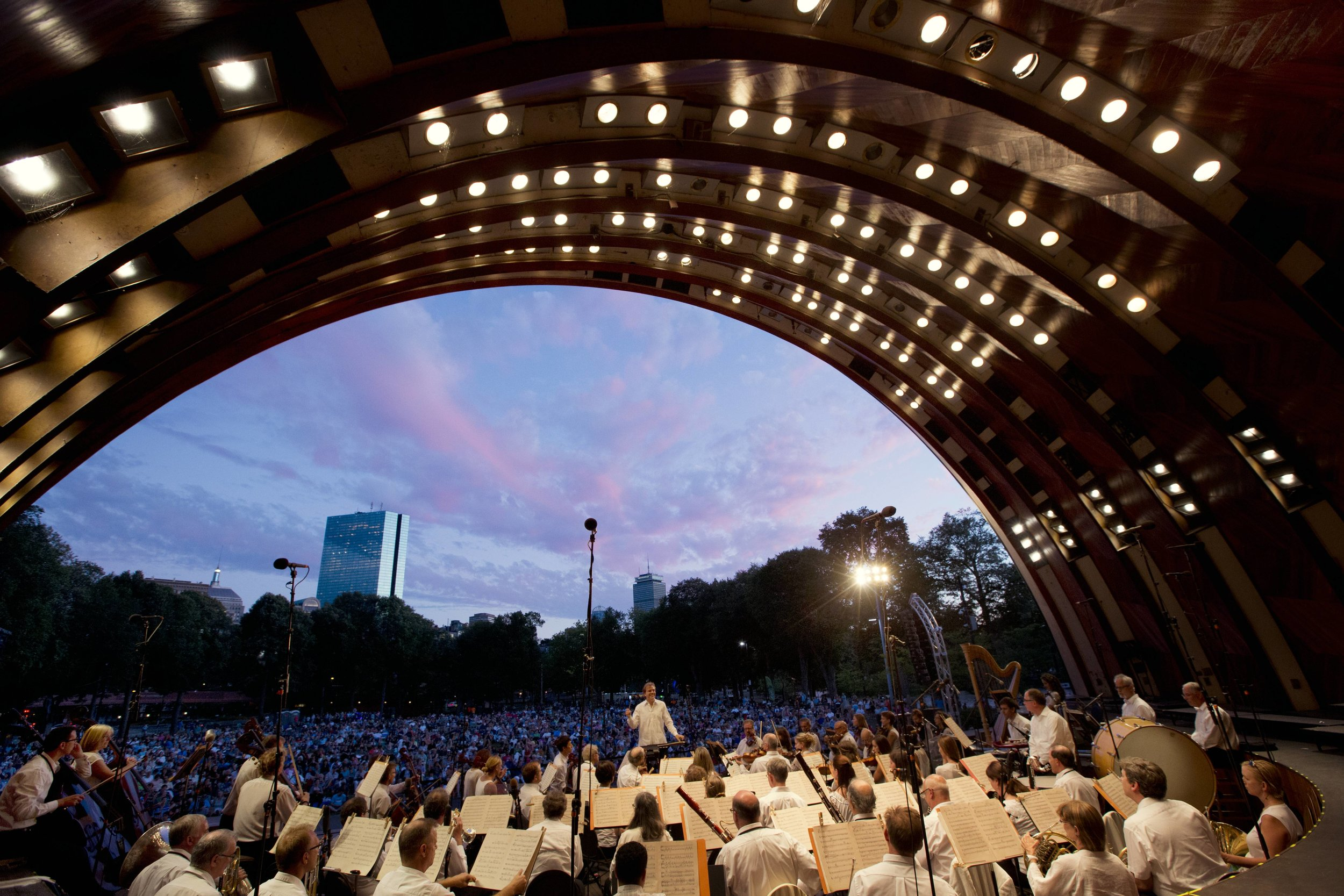 The horn and percussion sections' view from the Hatch Shell, as Christopher Wilkins conducts the Landmarks Orchestra. Michael Dwyer photograph