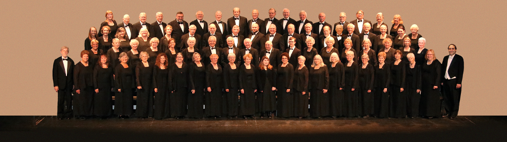 Chatham Chorale, with Joseph Marcio, director (far right) and Donald Enos (accompanist, far left).
