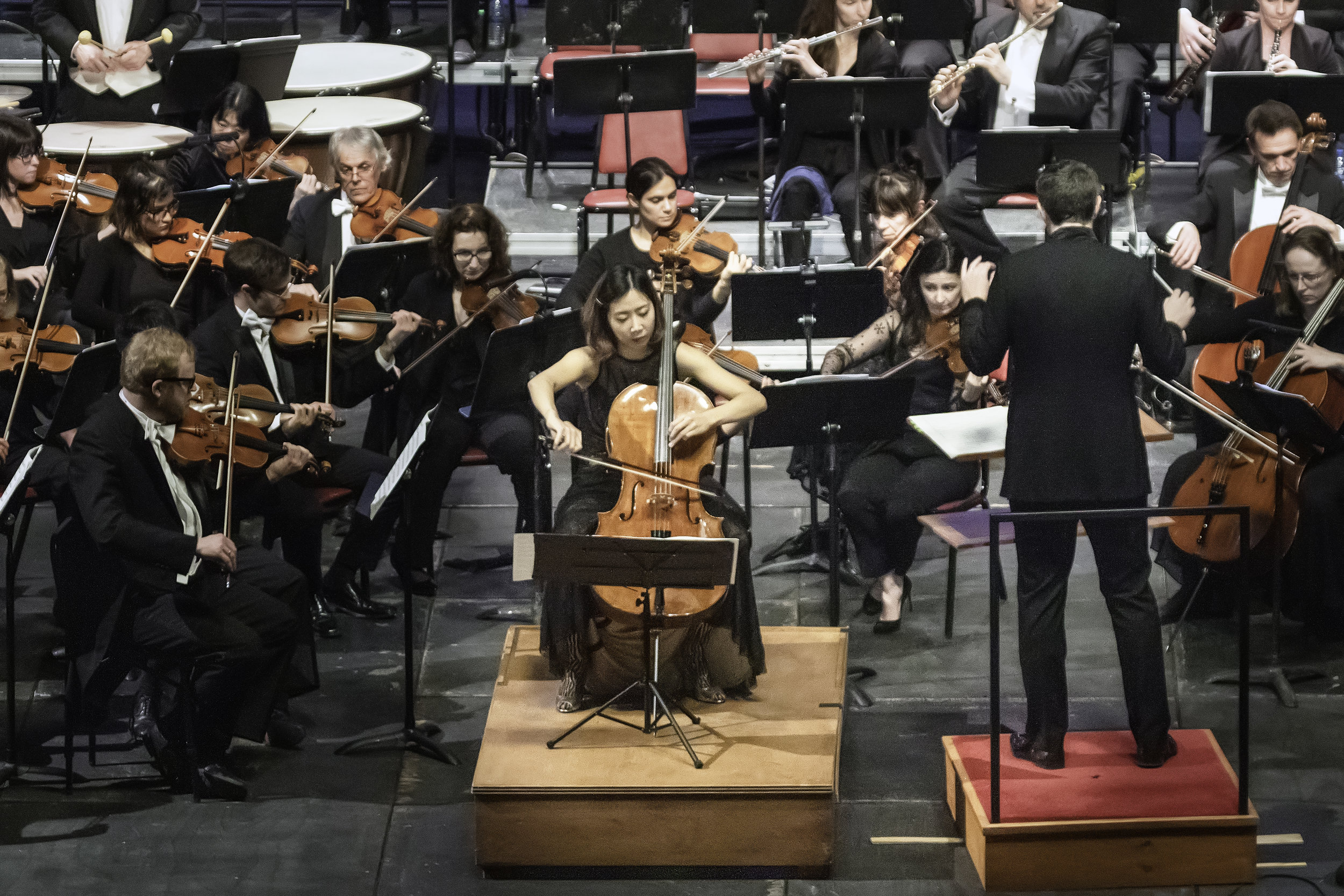"""Christine J. Lee performs Andrea Tarrodi's cello concerto """"Highlands"""" with the New Bedford Symphony Orchestra. Yaniv Dinur conducts. Richard Van Inwegen photograph"""