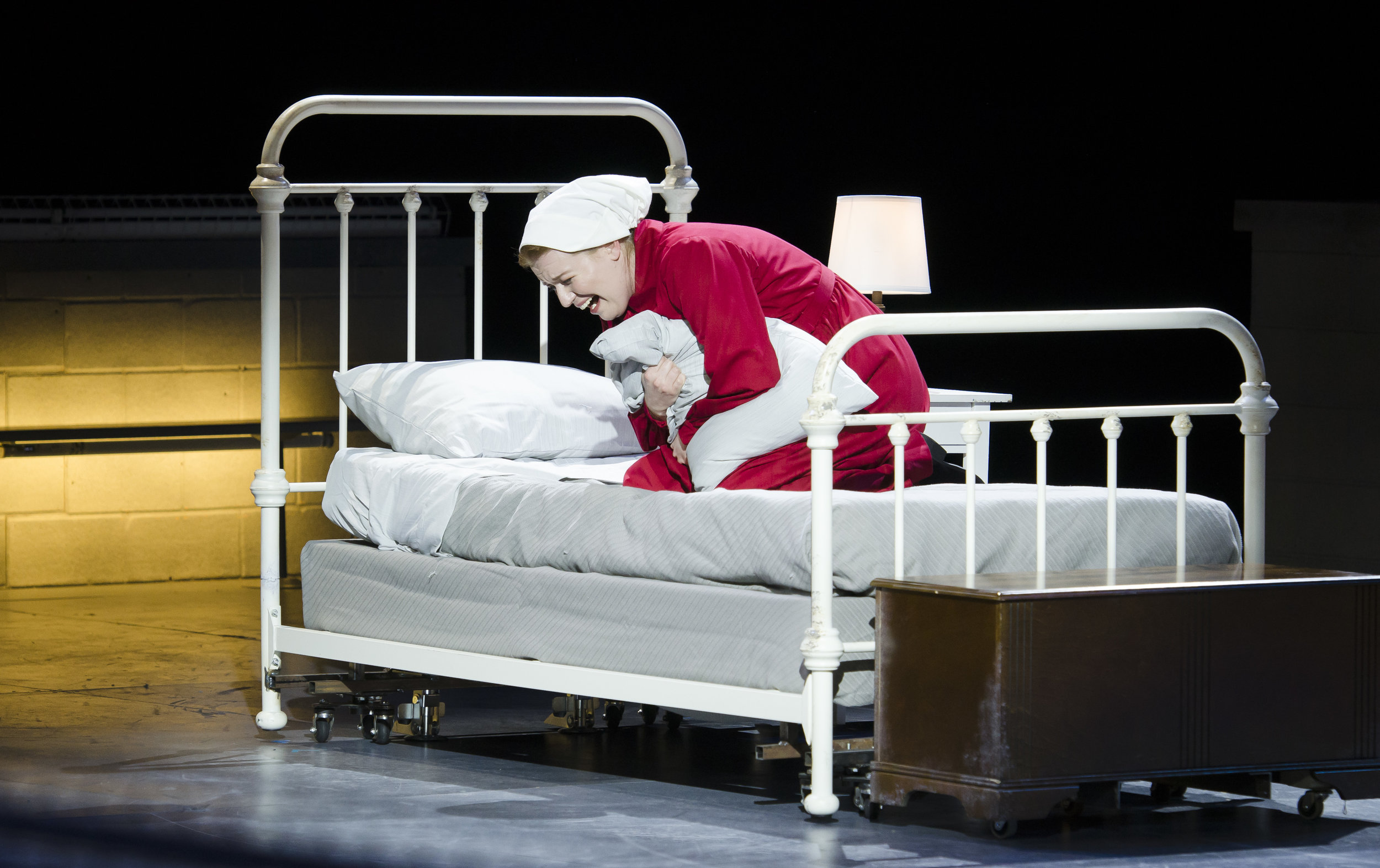 Offred (Jennifer Johnson Cano) despairs over the fate of her daughter in Boston Lyric Opera's production of The Handmaid's Tale. Liza Voll photograph