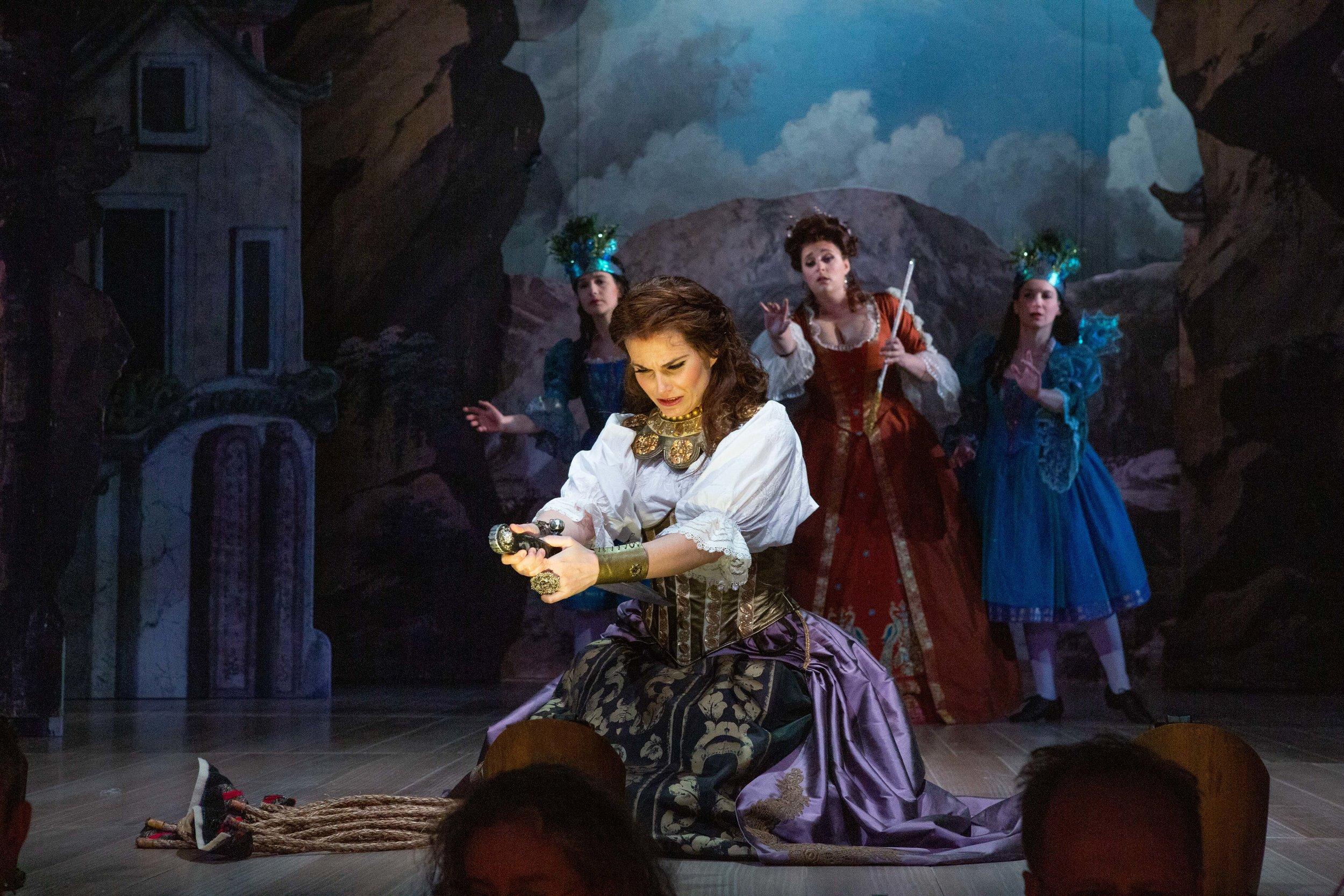 Soprano Emöke Baráth (as Bradamante) prepares to undo herself for love, in Steffani's Orlando generoso. Kathy Wittman photograph