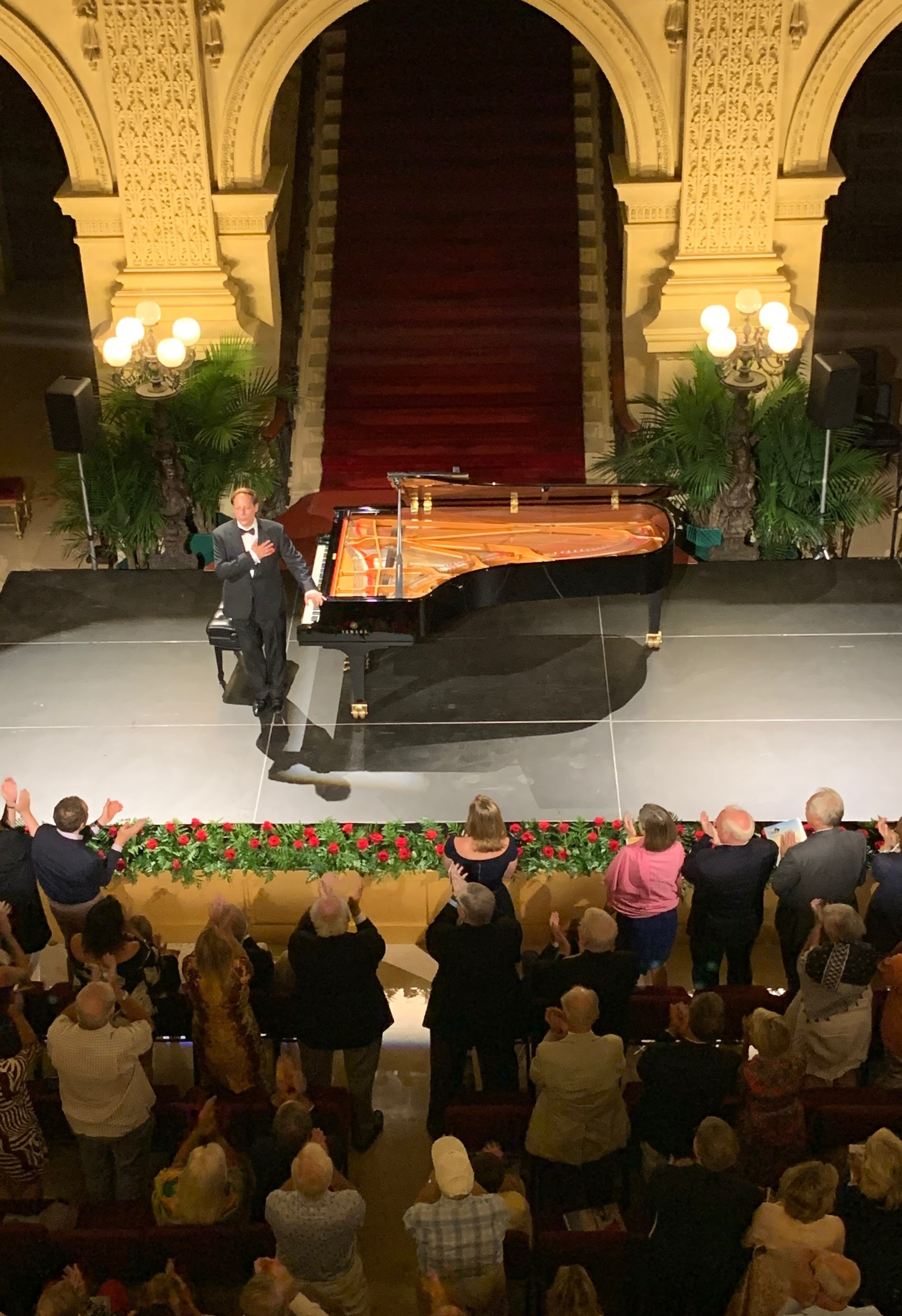 Michael Lewin, after performing Schubert's Wanderer Fantasy, takes a bow on the Breakers stage on opening night of the Newport Music Festival.