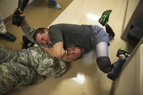 """""""Triple amputee and occupational therapist for bond of brothers during soldier's recovery."""" - Washington Post"""
