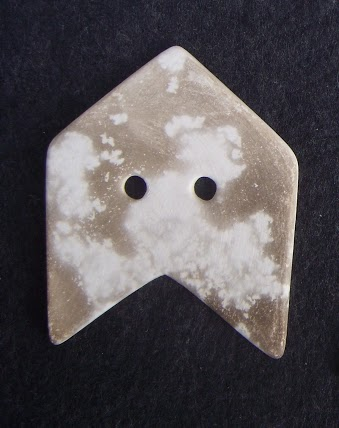Tessa Wolfe Murray's Ceramic Button reminds me of an arrowhead