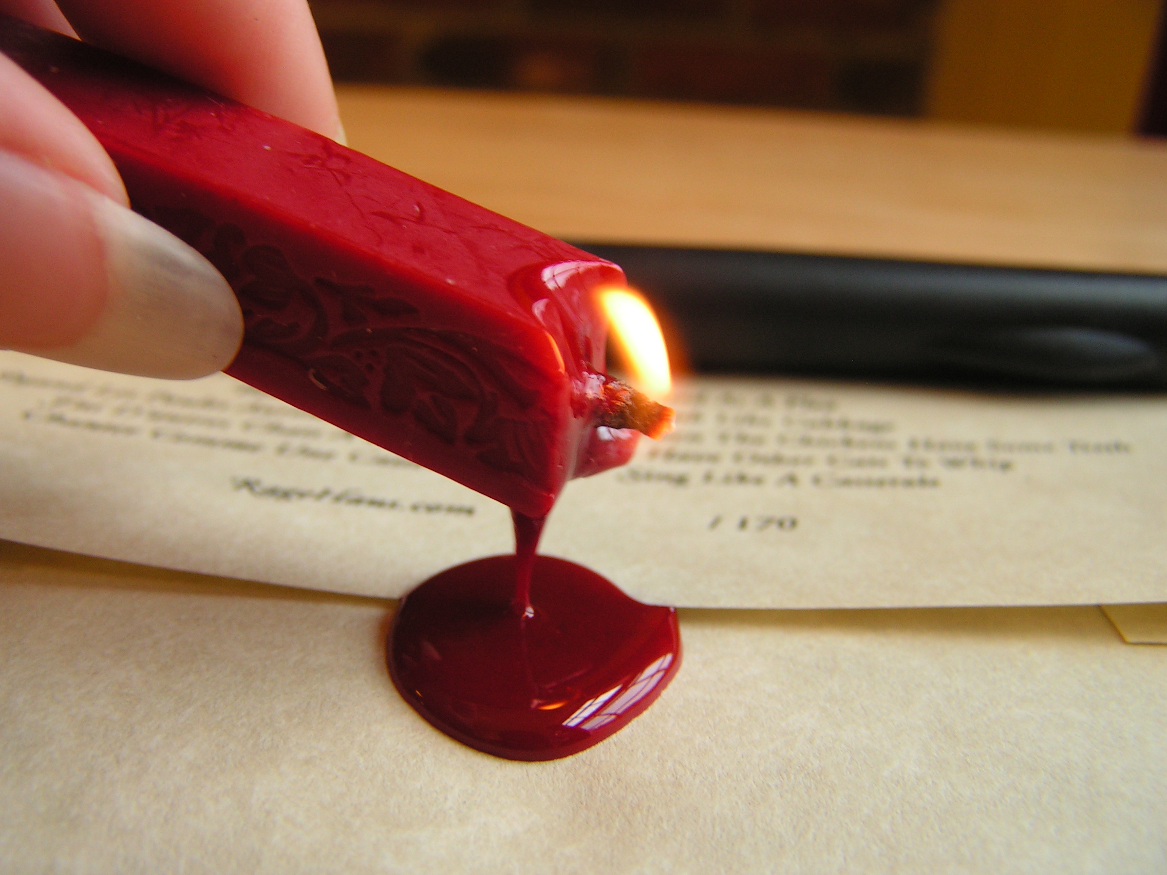 Gloopy drip of hot sealing wax