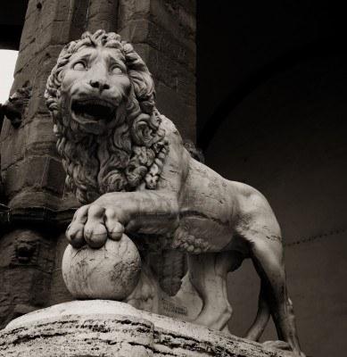 12452215-stone-lion-statue-at-piazza-della-signoria-in-florence.jpg