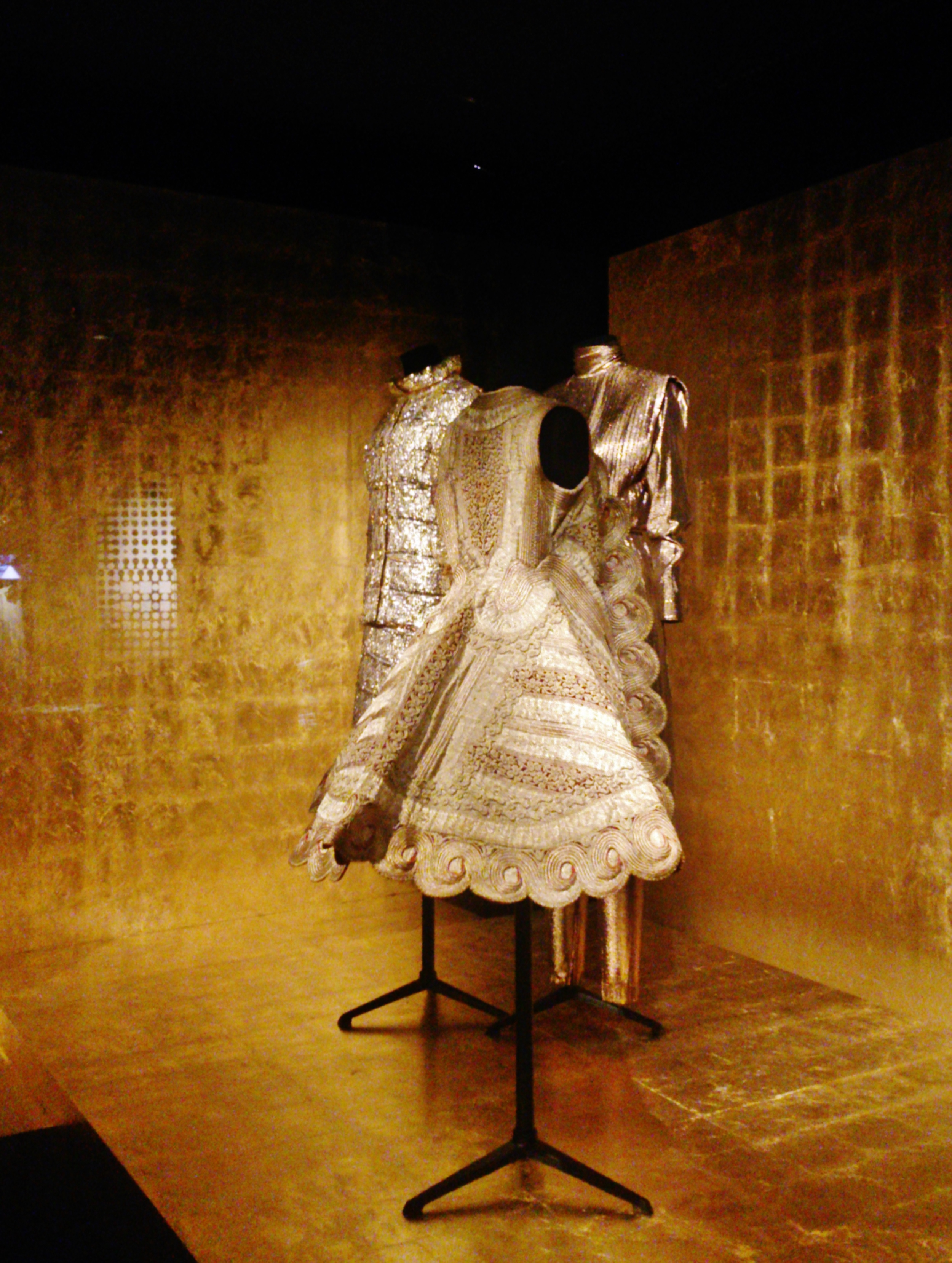 Golden garments, at Dries Van Noten's current Paris exhibition including a beautifully embroidered antique piece.