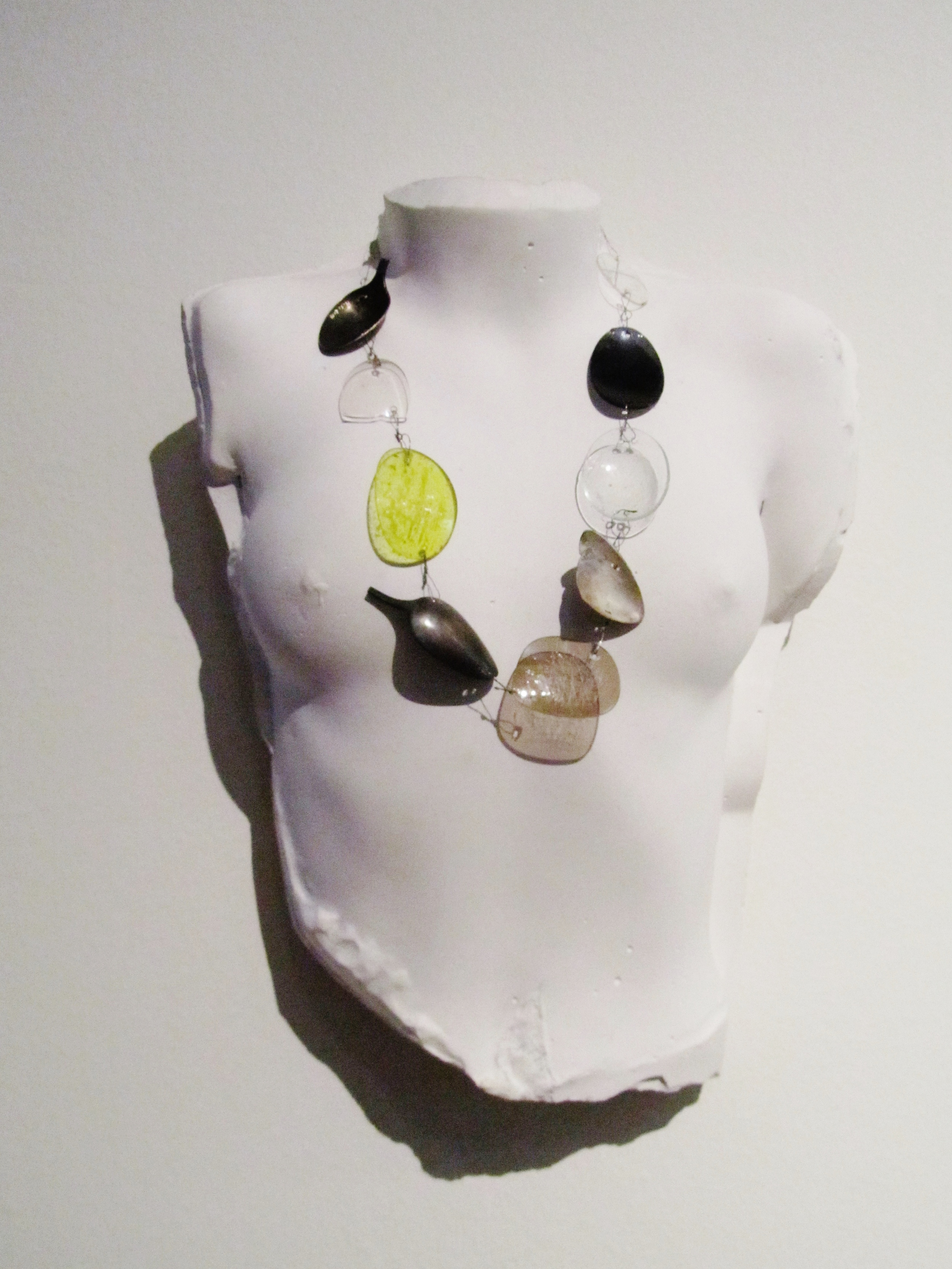 Lens Spoon Chain 2013 silver, steel, glass, acrylic    The busts are cast from Schobinger's own daughter when she was a young girl.