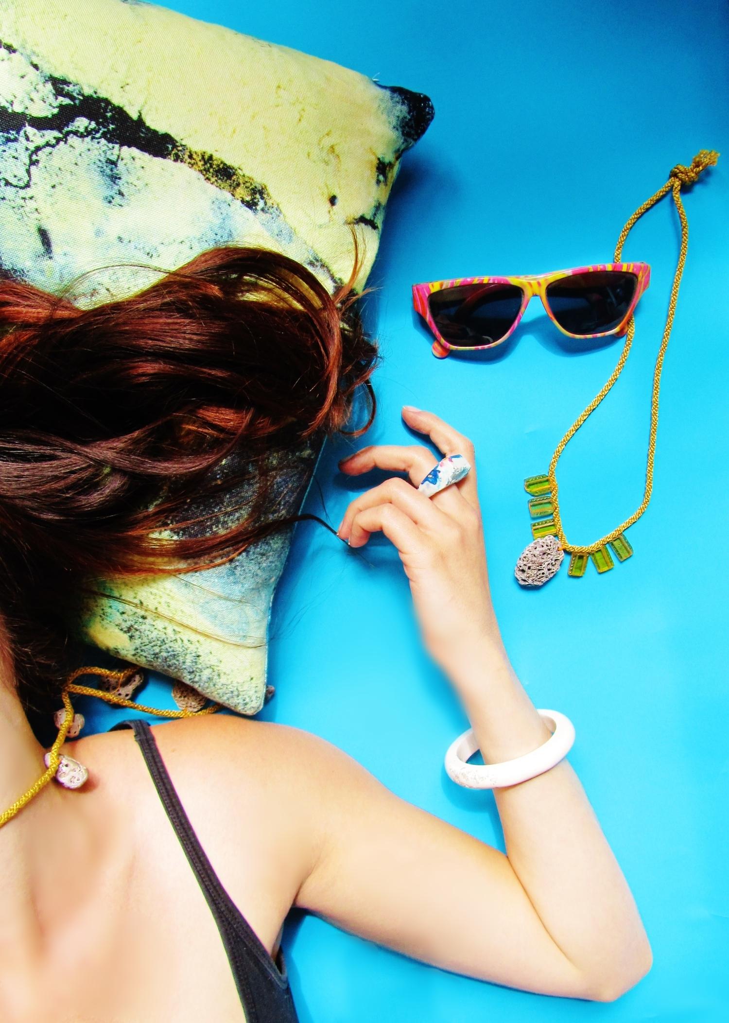 jade mellor blue background still life sunglasses mermaid hair cushion necklaces white bangle ring.JPG