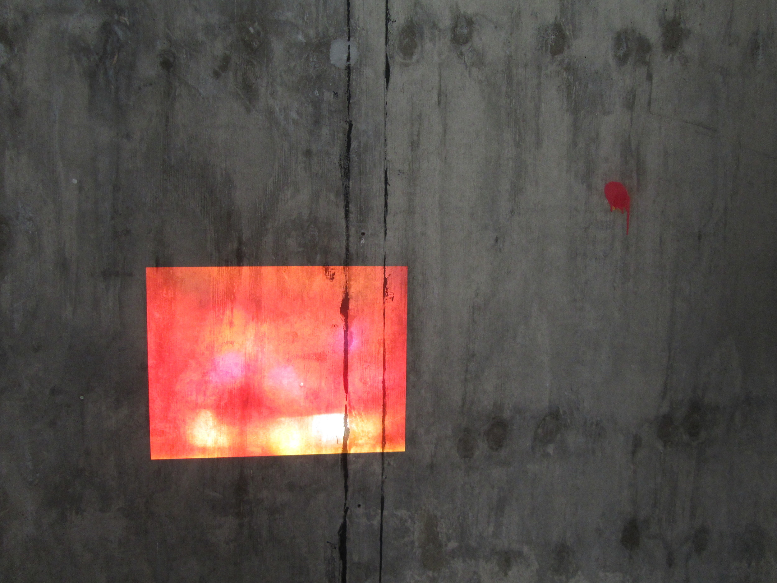 Holly Rowan Hesson's  Riot  2014 Projects directly onto the bare grey walls.
