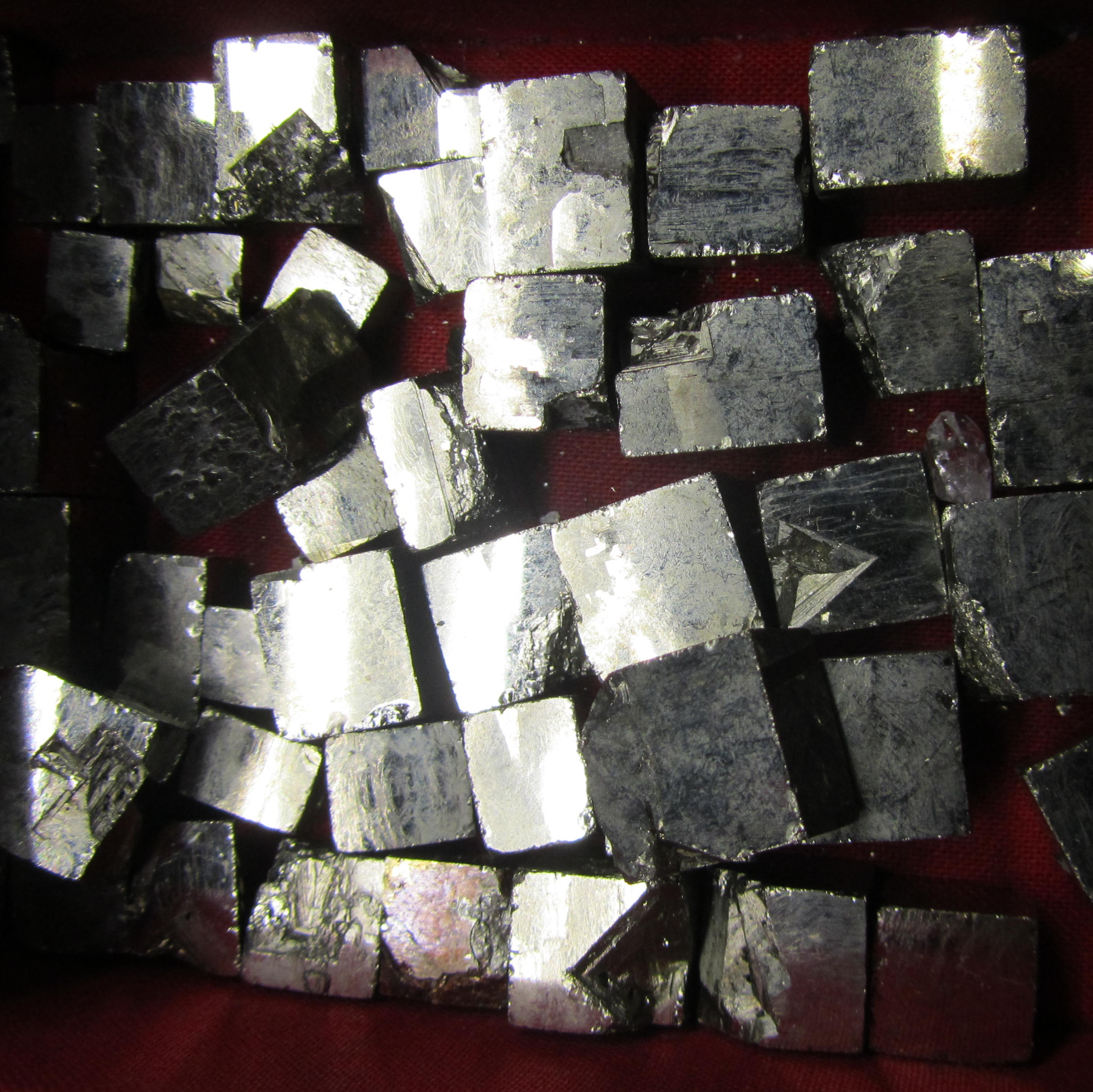Box of pyrite specimens: A cube of cubes...