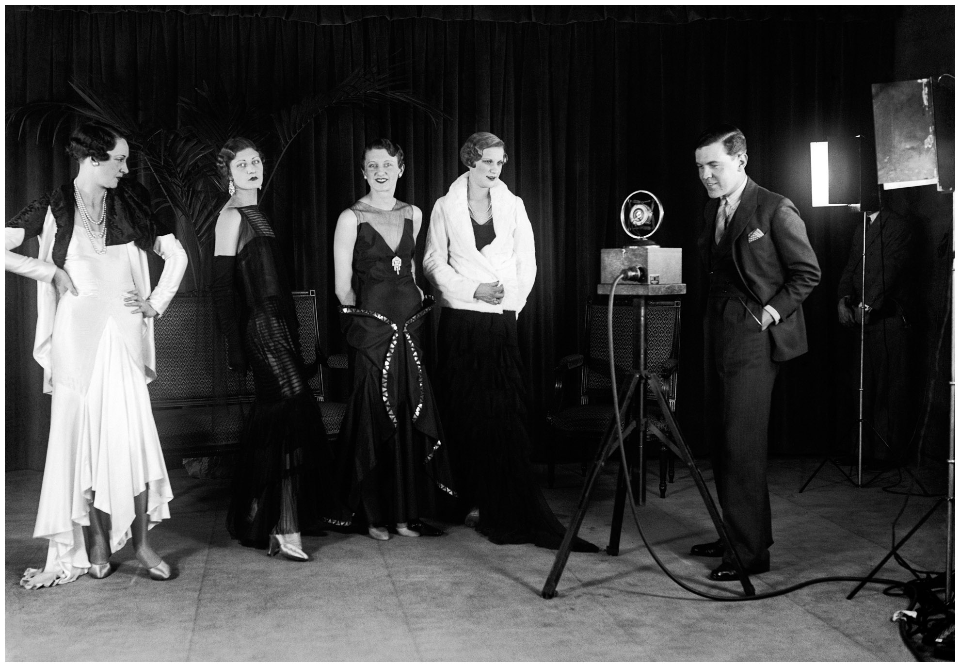 Norman Hartnell with his models in 1930 courtesy of Getty Archive