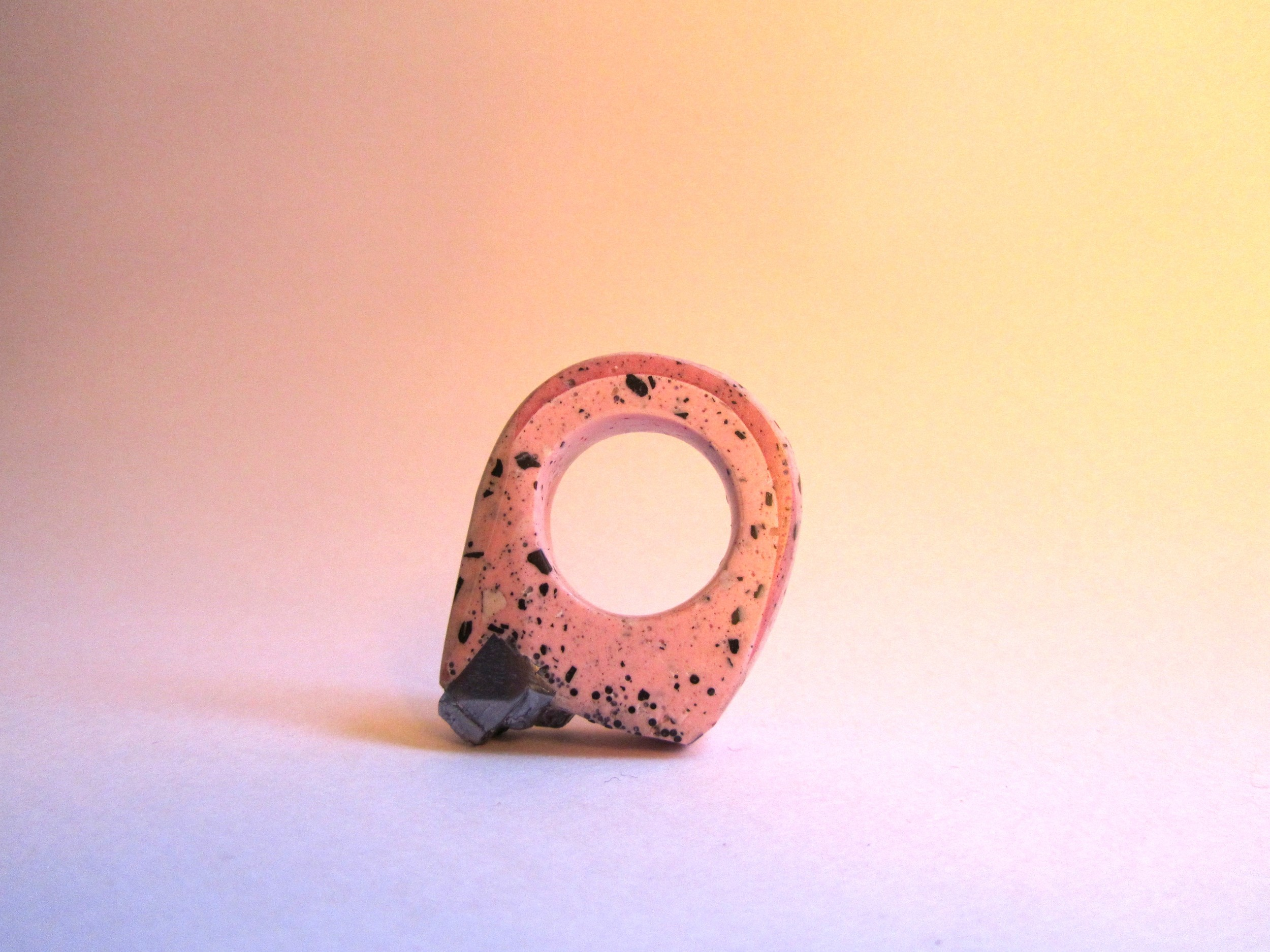 The commissioned pink pyrite ring