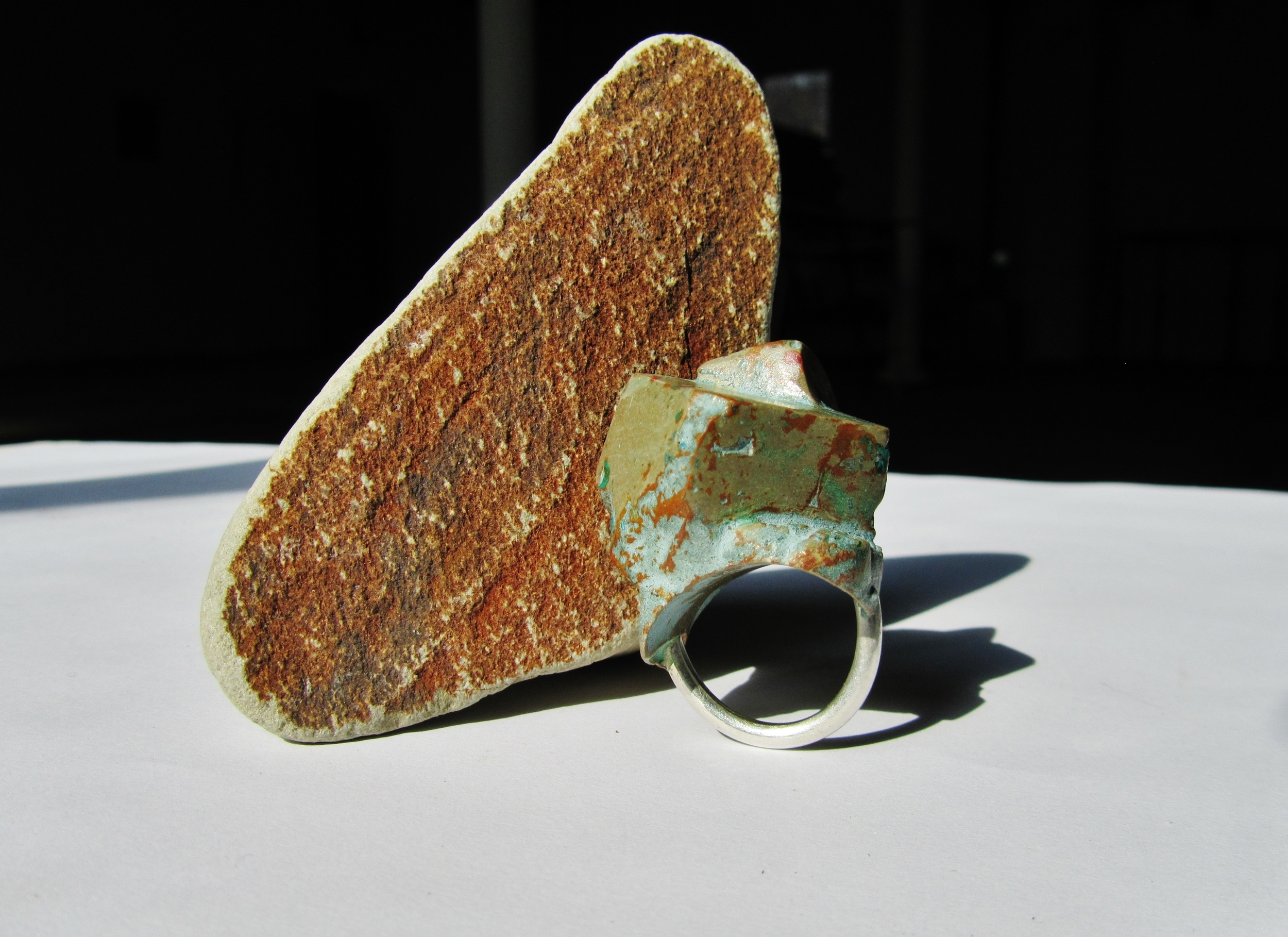The patina of weathered copper as it is exposed to the elements is the inspiration behind this rugged square ring of resin and silver.