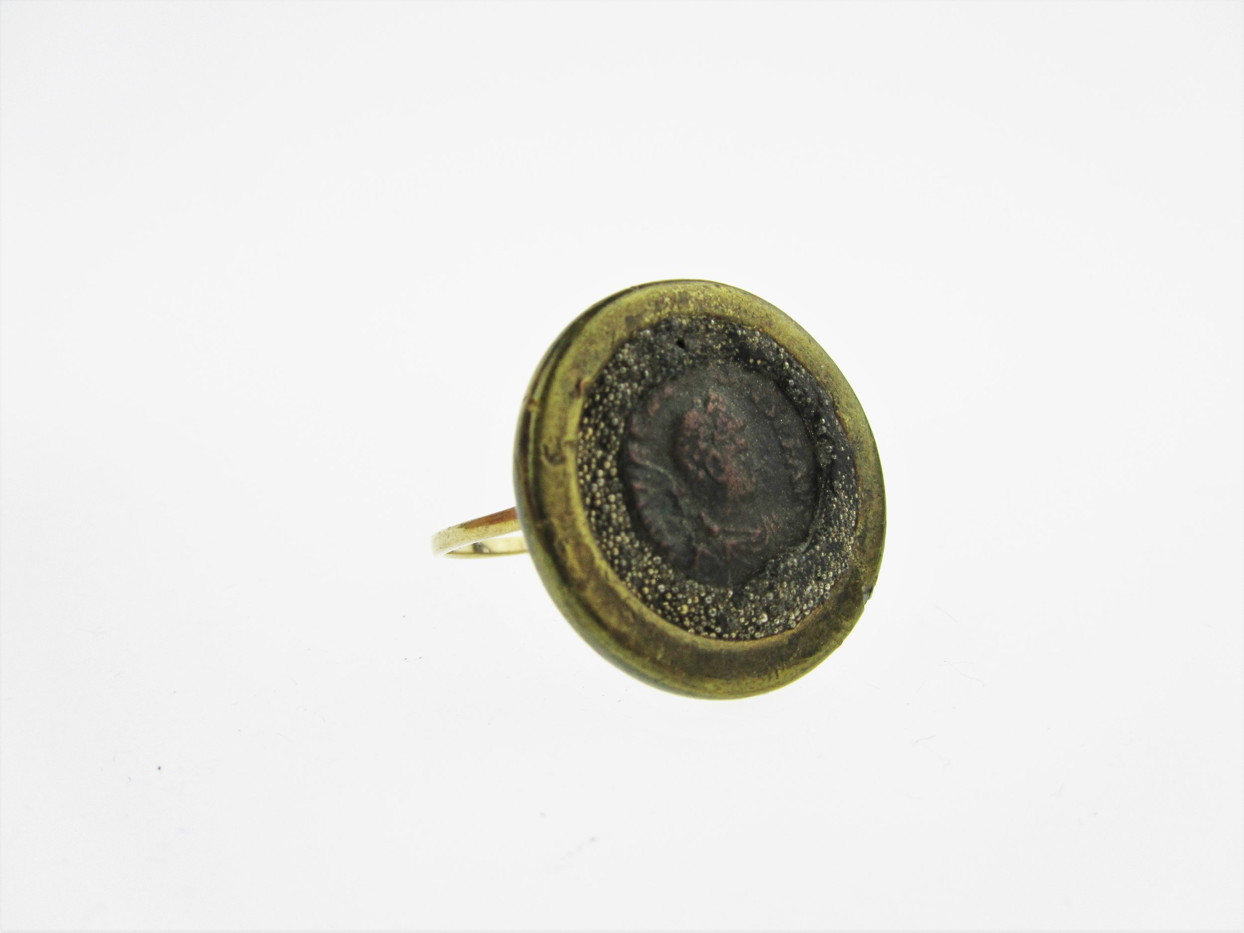 DETECTORIST'S POCKET - metal detecting unearths everything lost &buried over the centuries. Ranging from modern dross to ancient treasure, you never know what you will be find when you start digging into the earth.This ring is made from an antique gold ring, Roman coin, brass washer and red glass gem.