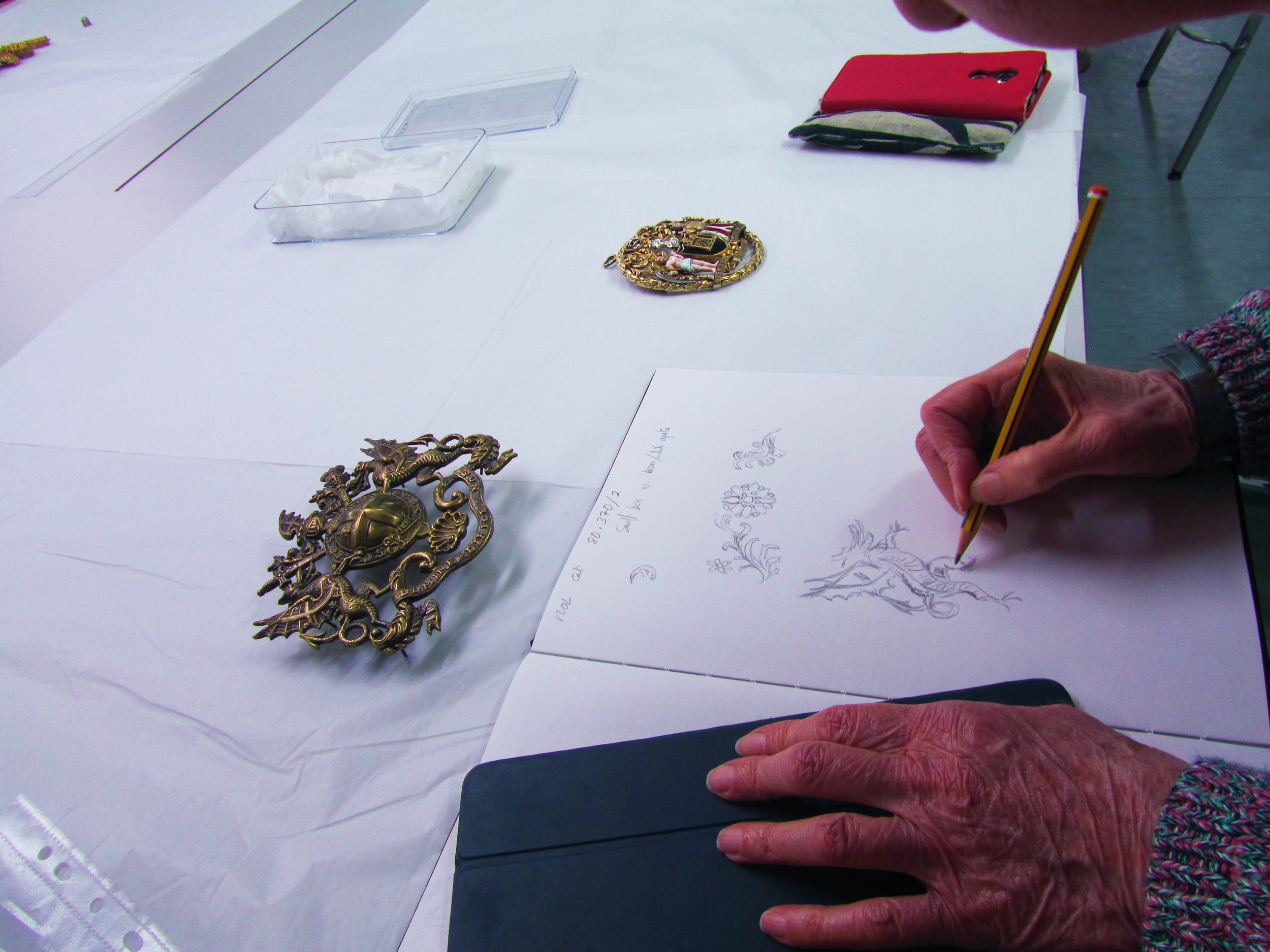 Drawing the real object  rather than just photographing to record important details and understand how it was made.