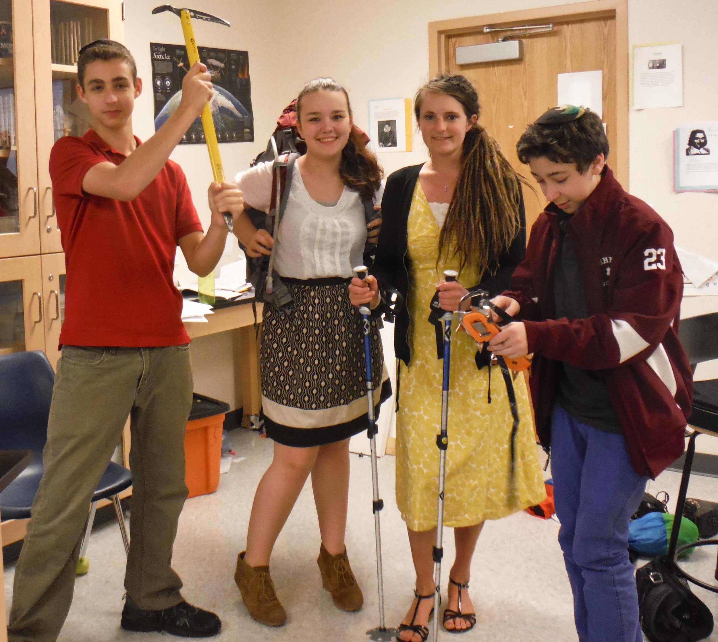 """Students at the Hebrew High School of New England help Sarah (second from right) model some of the gear that she'll use to traverse the Juneau Icefield. """"They can't wait to see how I use an ice axe."""""""
