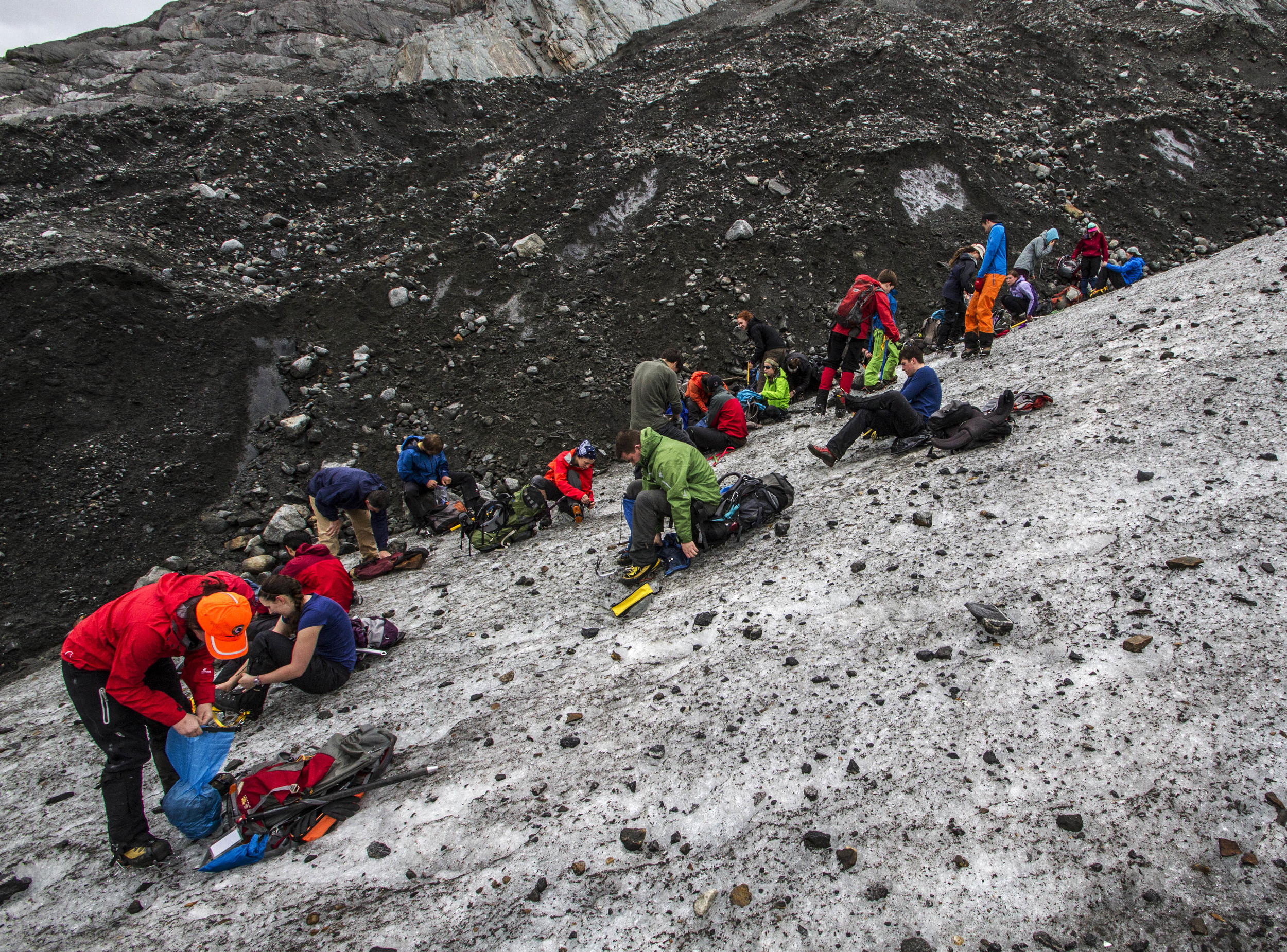 The group puts on crampons for some practice on the lower Mendenhall Glacier.  Photo:  Adam Taylor