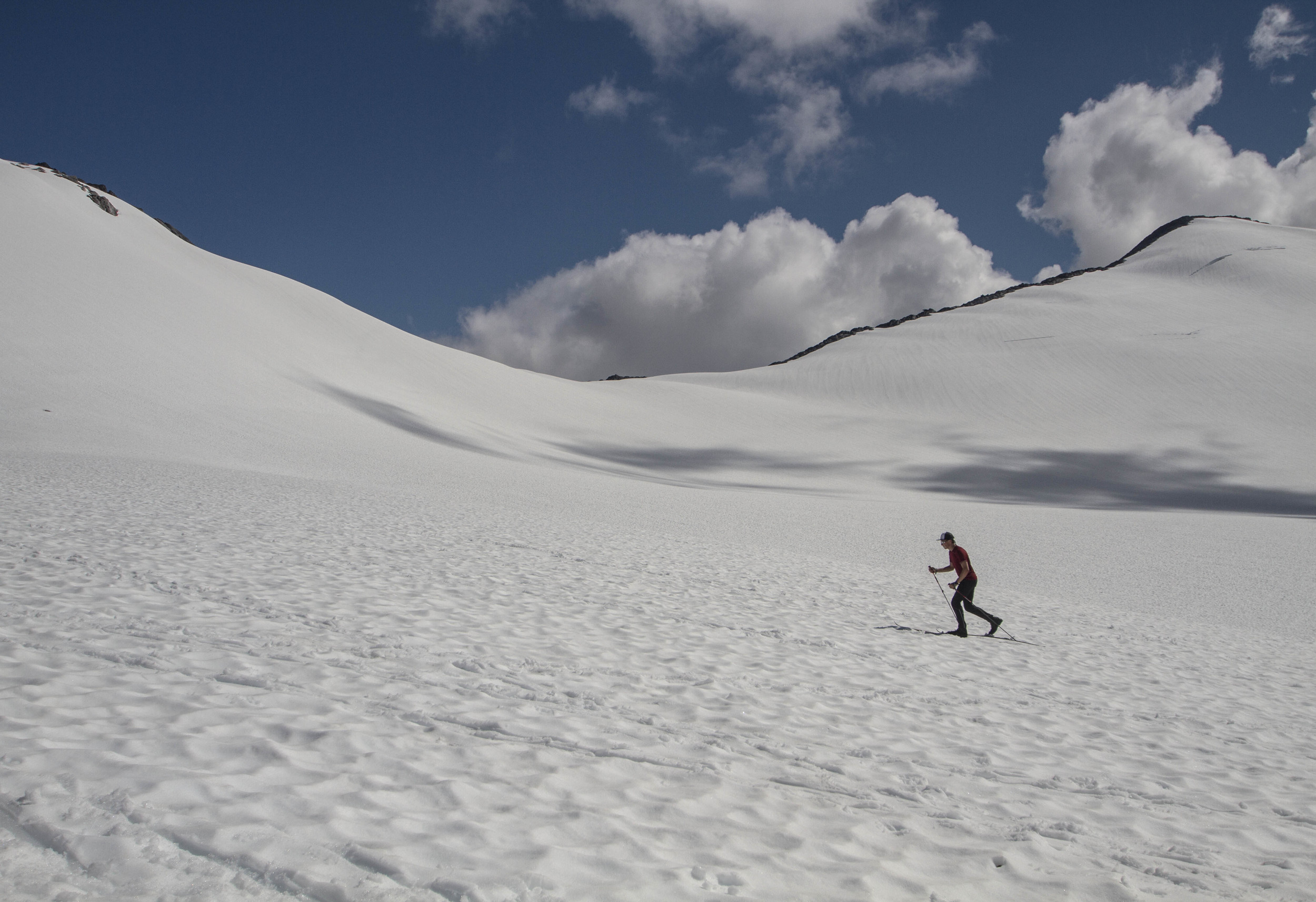 JIRP student Grayson Carlile takes advantage of a sunny day with some ski practice on Lemon Creek Glacier. Photo: Adam Taylor