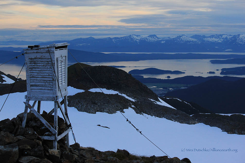 The meteorological station at Camp 17 with Ptarmigan Glacier below and Auke Bay, Lynn Canal, and the Chilkat Mountains in the distance. Photo: Mira Dutschke
