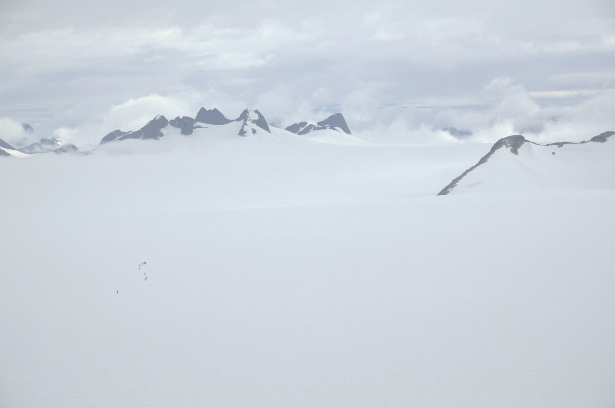 Trail Party One skis across the Taku Glacier – as seen from Camp-10, their destination. Photo by J.L. Kavanaugh
