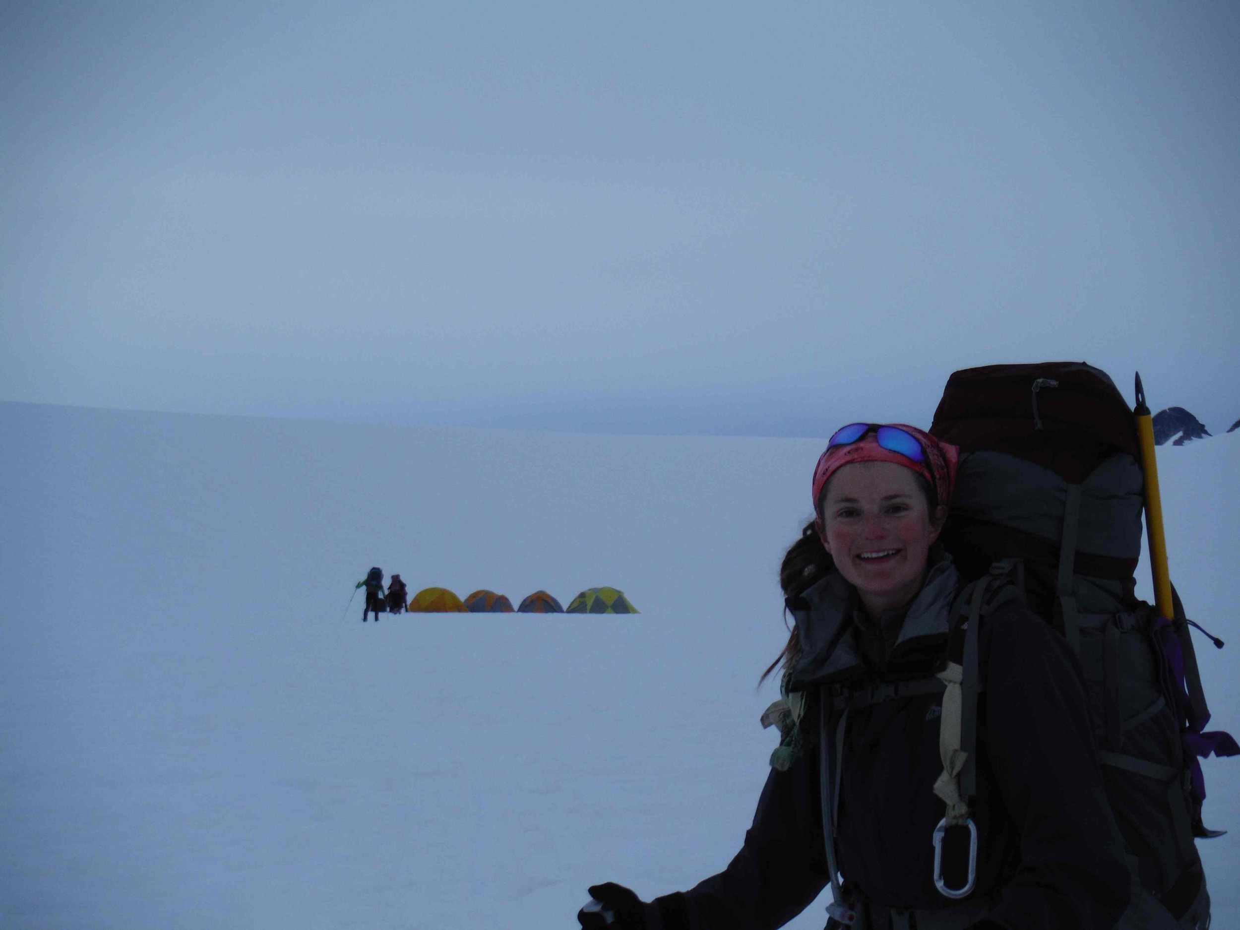 Sarah Bouckoms smiles at the sight of the Norris Cache after a long day.  Photo by Jamie Bradshaw.