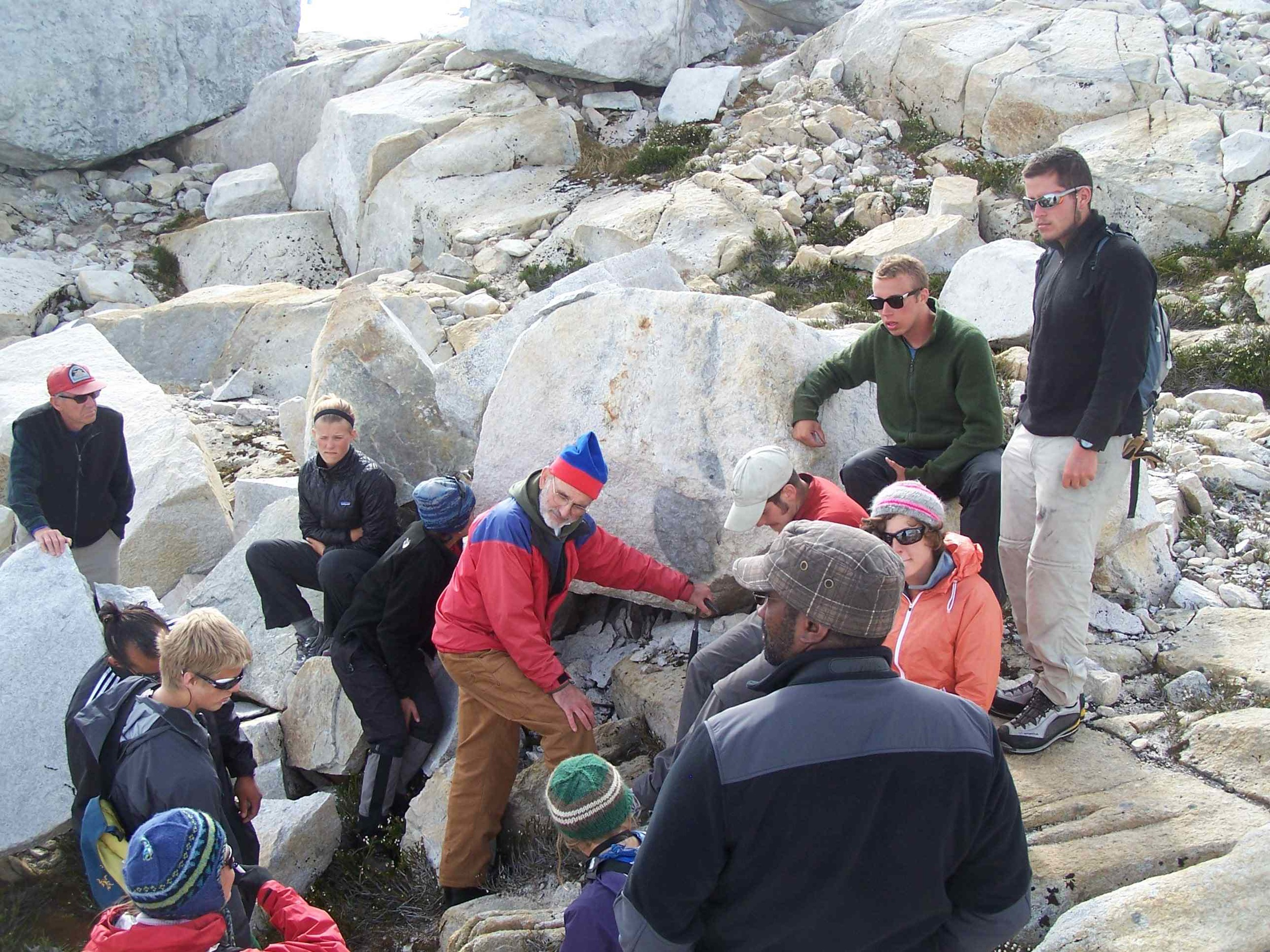 Dr. Jay Fleisher (in red jacket) leads a geology field trip near Camp 10.  Photo by J. L. Kavanaugh