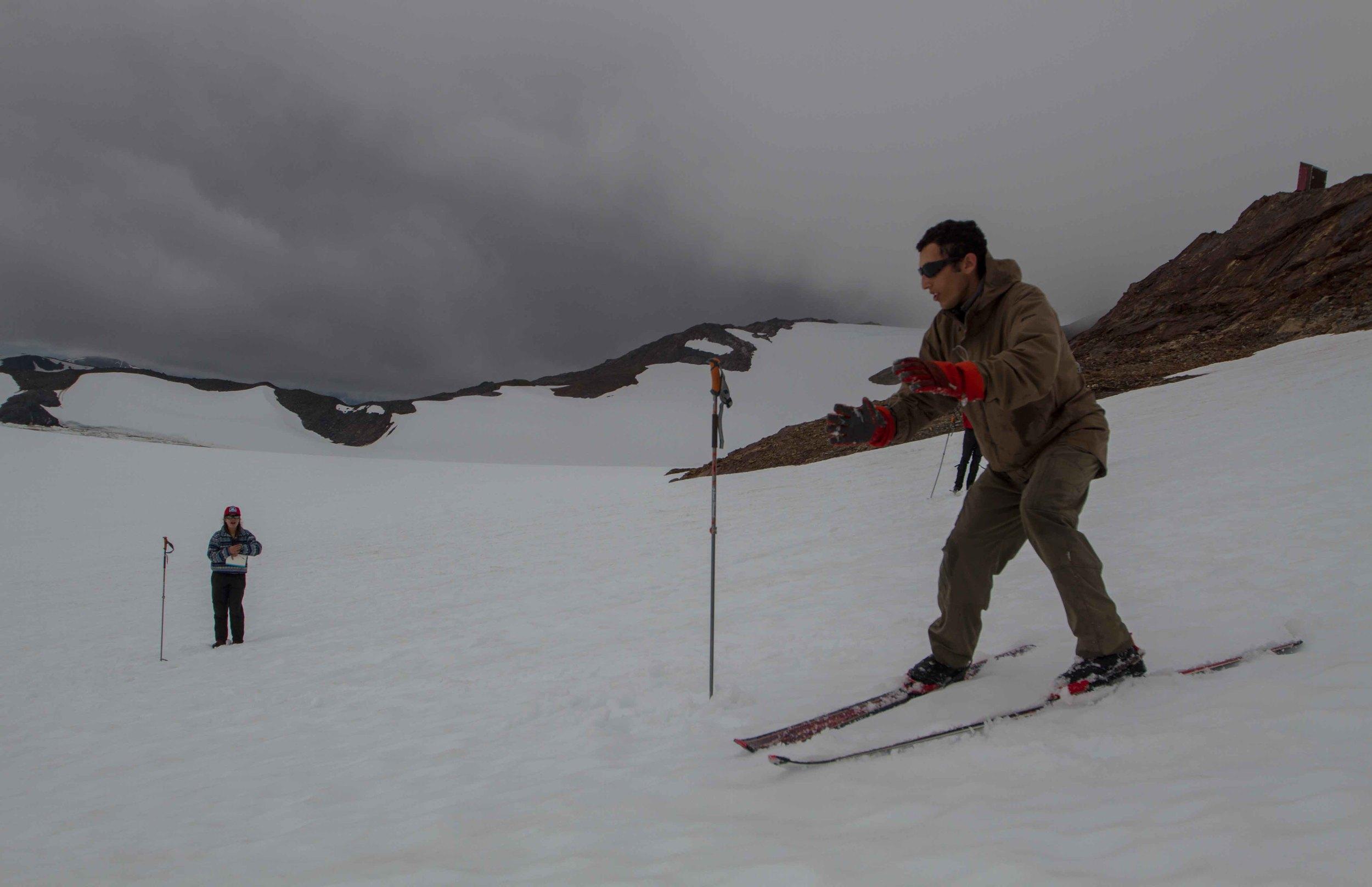 Kamil Chadirji-Martinez comes down the hill while Kate Baustian times. Photo by Adam Taylor