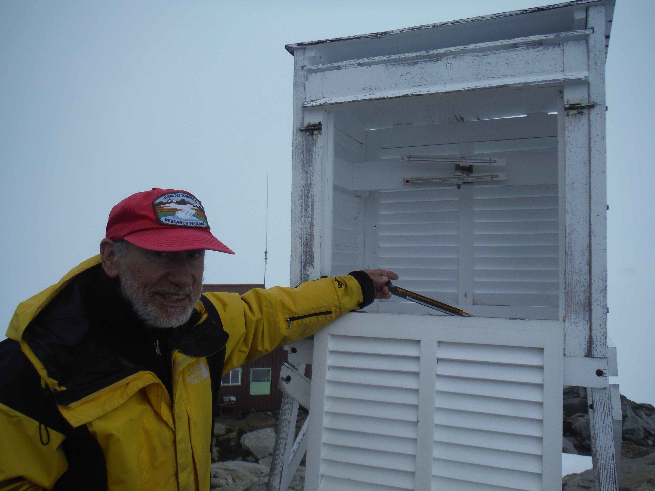 Alf Pinchak at Camp 10 alongside one of his beloved Metshelters.  Photo by Sarah Bouckoms