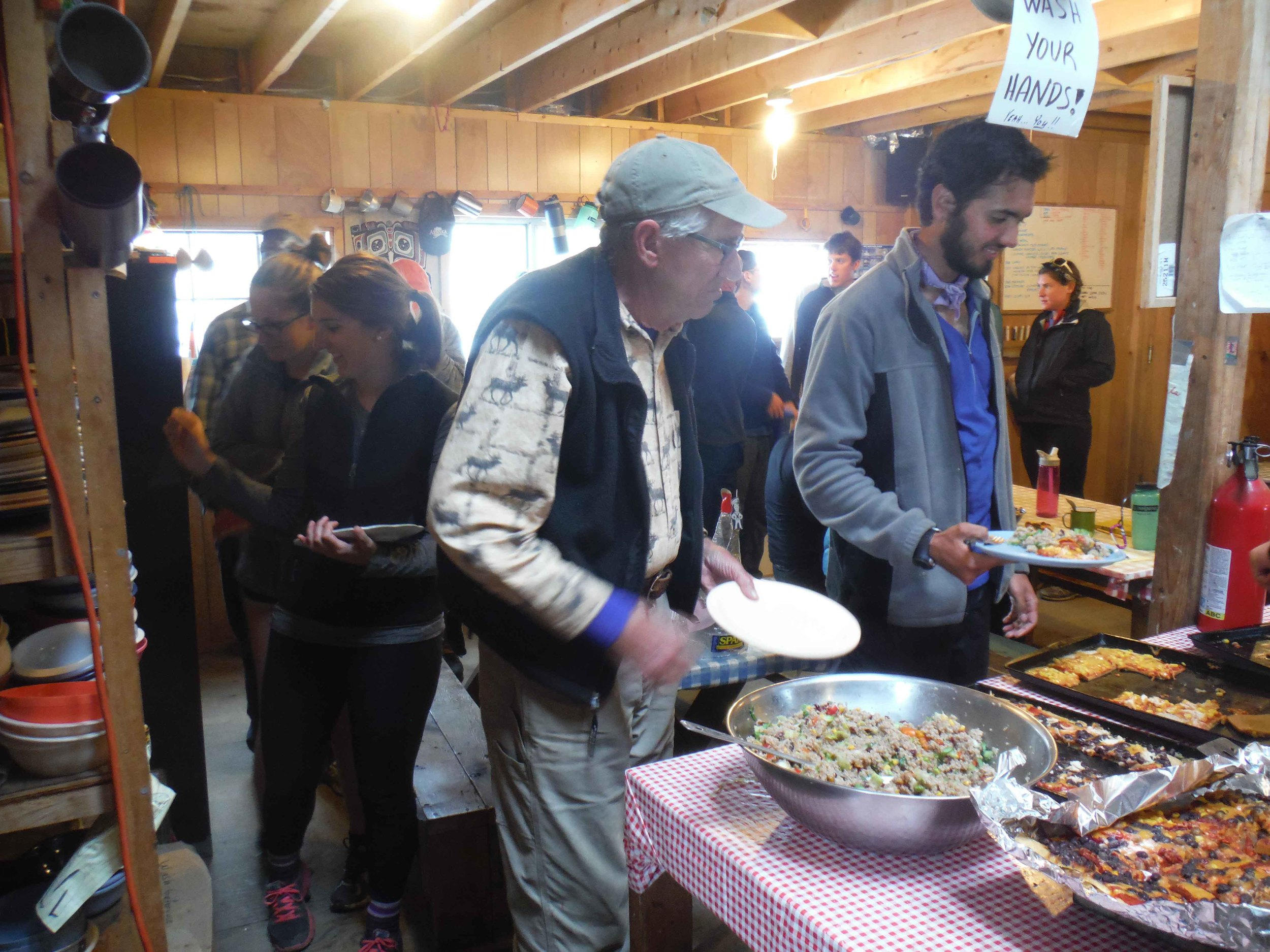 Jay Beeman and Dr. Bill Isherwood start the food line that goes through the cook shack and out the door. Photo by Sarah Bouckoms