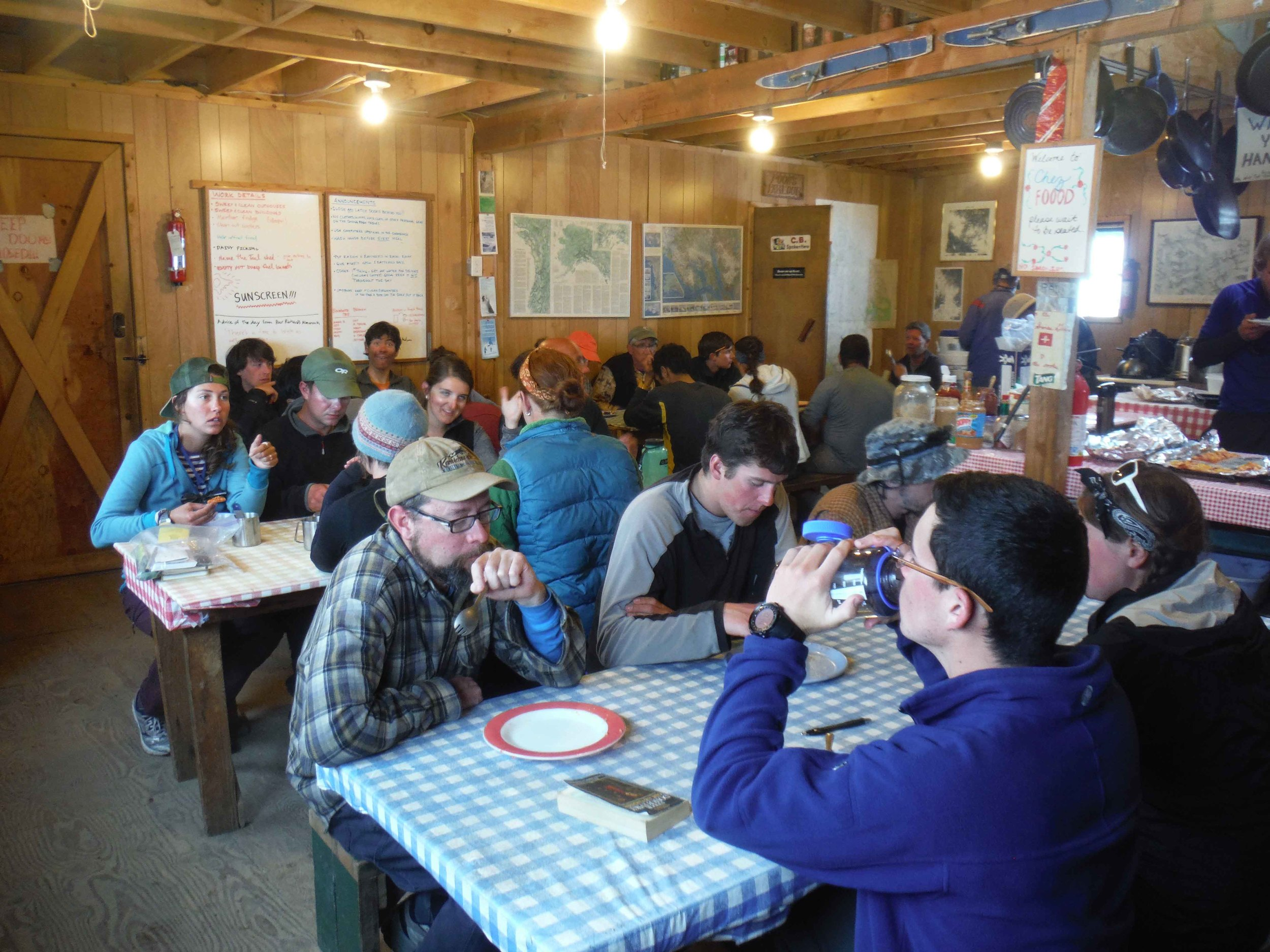 Hungry JIRPers enjoying another fantastic meal at Camp 10. Photo by Sarah Bouckoms