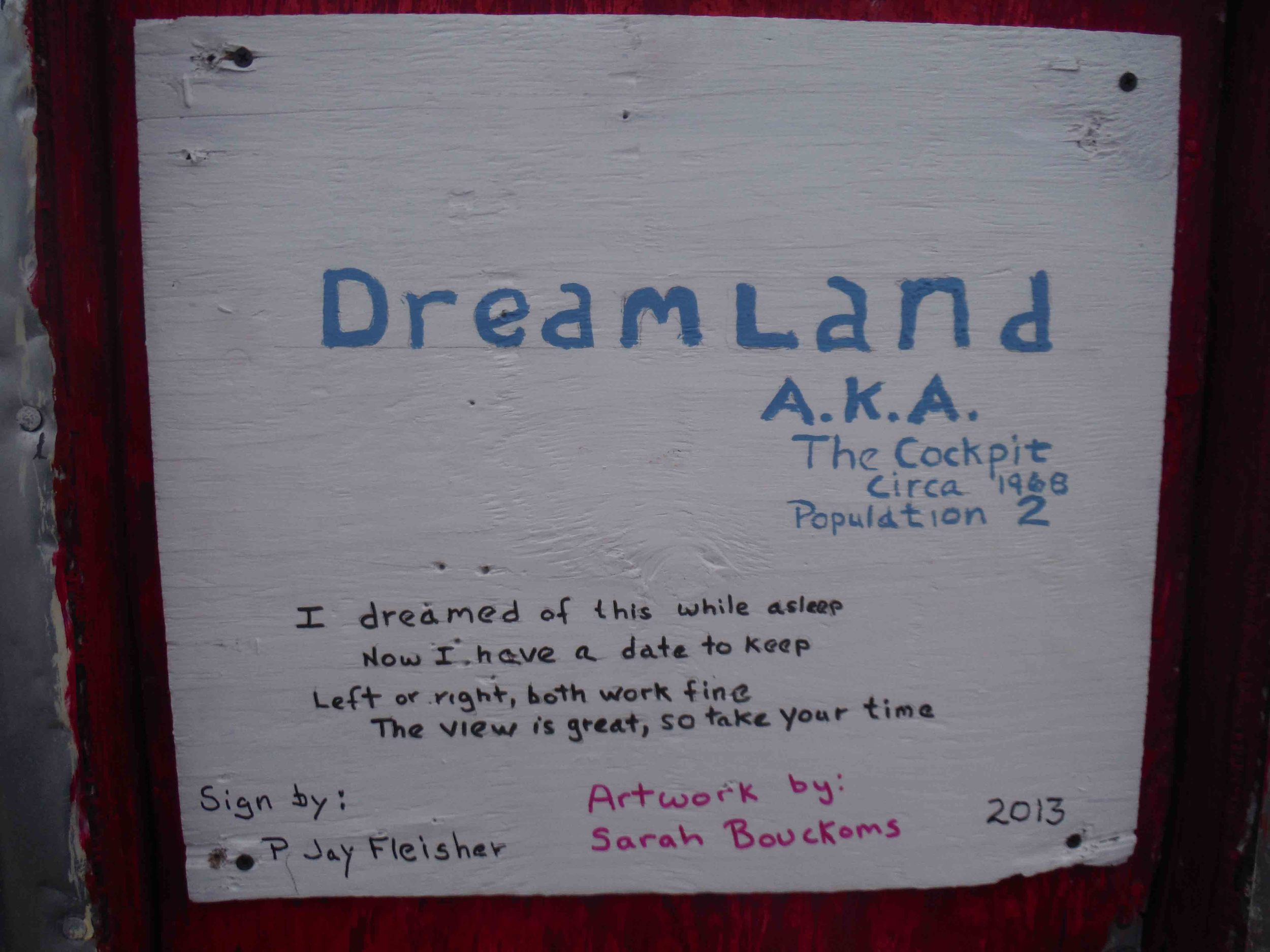 "The new sign on the freshly painted door of ""Dreamland"" with poetry by P. Jay Fleisher.  Photo by Sarah Bouckoms"