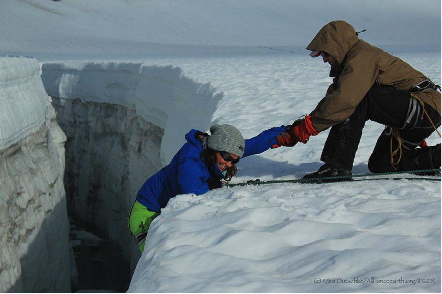 Sometimes it is hard to get out of the crevasse.  Luckily, in JIRP you can ask a friend for help.  Here Kamil Chadirji-Martinez assists Justyna Dudek over the lip.  Photo by Mira Dutschke.