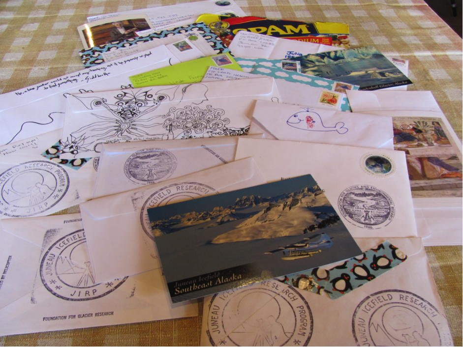 A variety of letters and postcards ready to be sent to loved ones.  Photo by Lindsay Starr