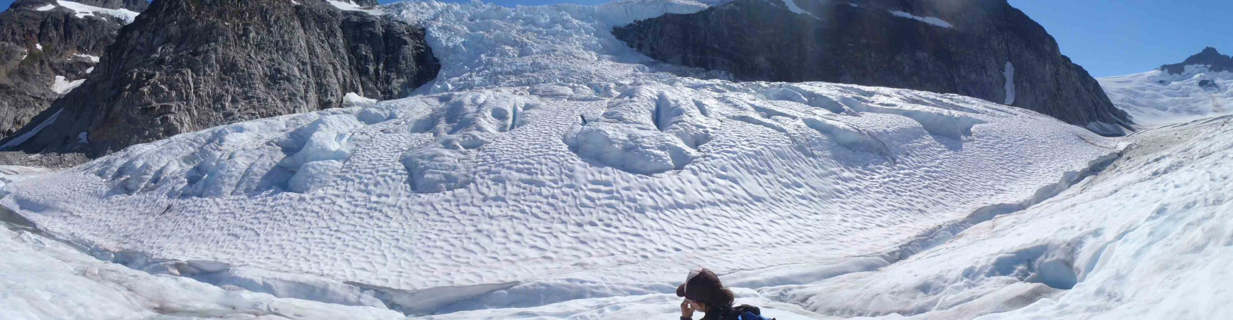Panorama of one of the ogives near the base of the Vaughan Lewis Icefall (in the background).  Photo by William Jenkins.