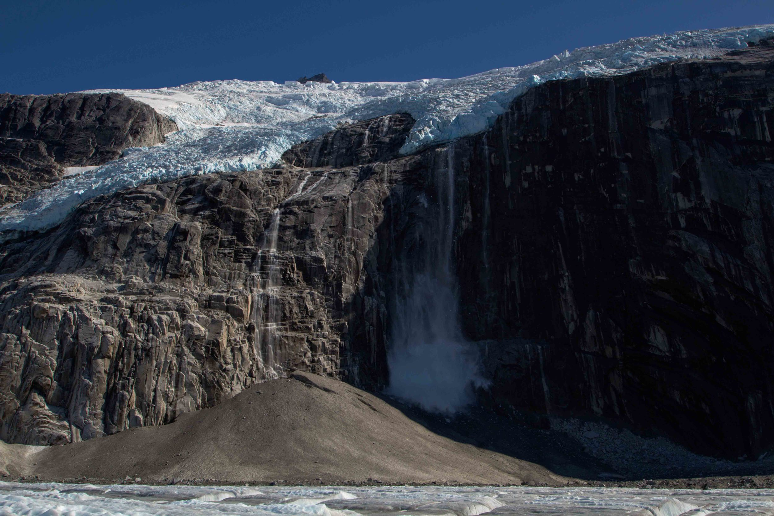 A calving event of one of the hanging glaciers above the Gilkey Trench.  Photo by Adam Taylor.