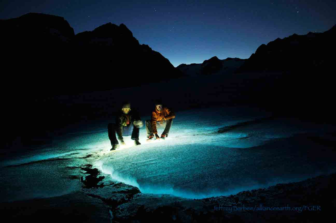 The surface of Gilkey Glacier lit by headlamps at night.  Photo by Jeffrey Barbee.