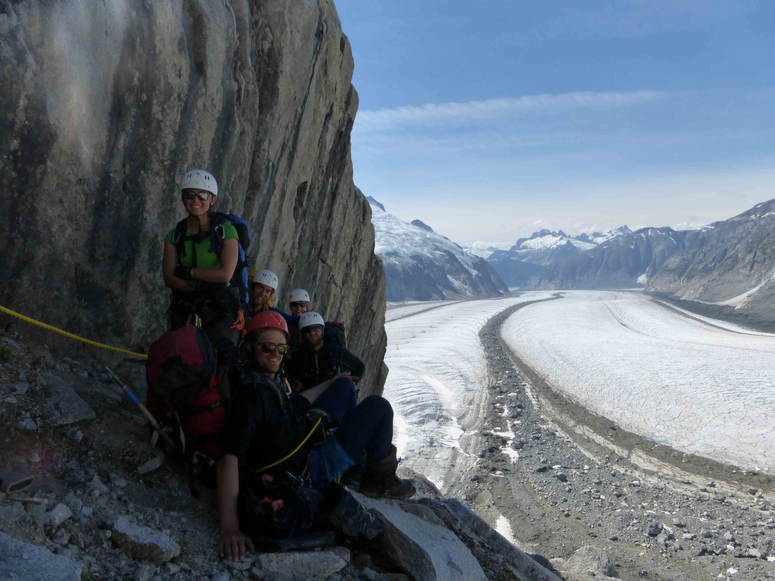 Waiting to ascend fixed ropes on the climb back to Camp 18.  Gilkey Trench in the background.  Photo by Adam Toolanen.