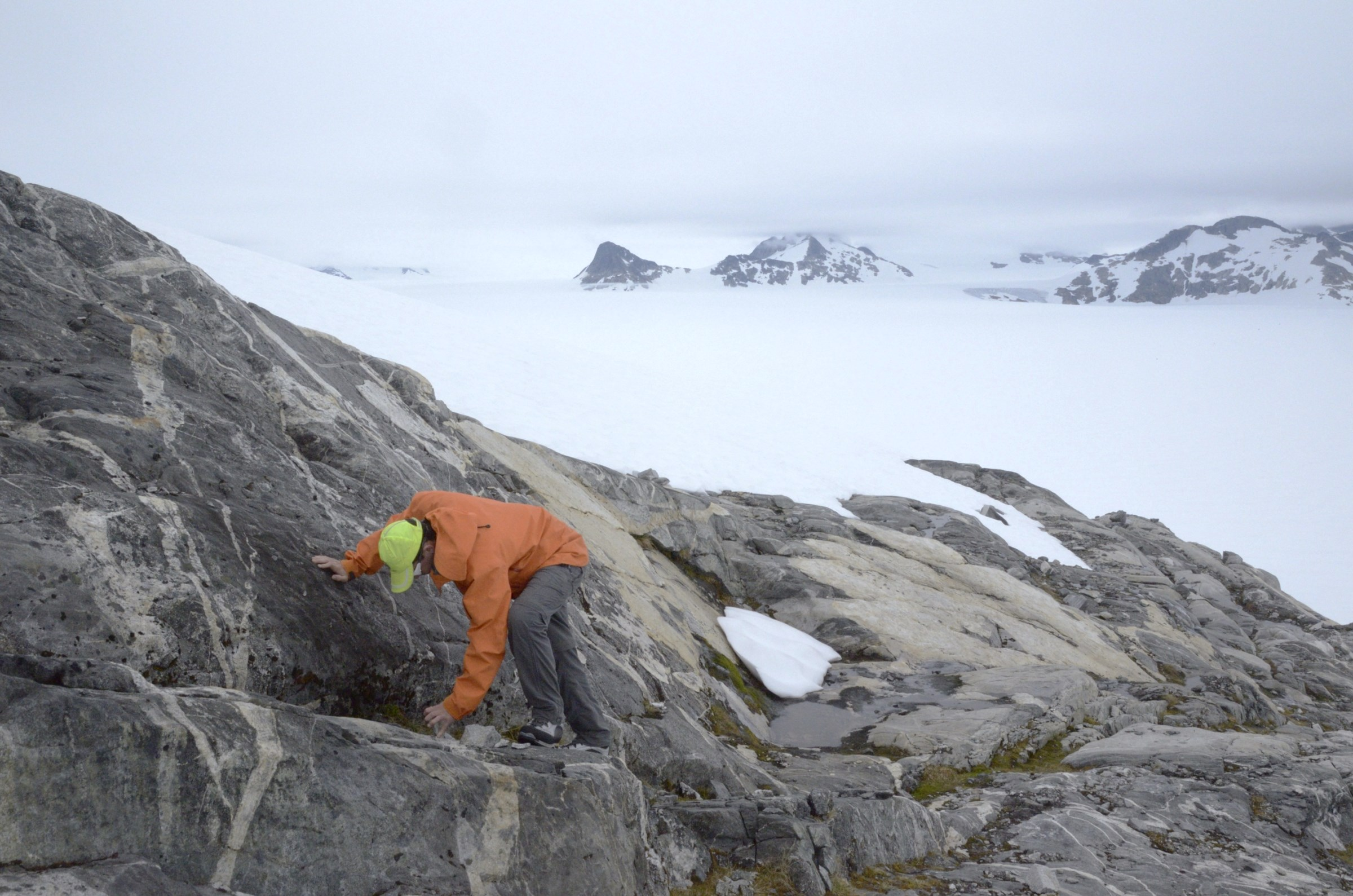 Ben Slavin collecting at Shoehorn Mountain, across the main branch of Taku Glacier from Camp 10.  Photo by Jeffrey Kavanaugh.