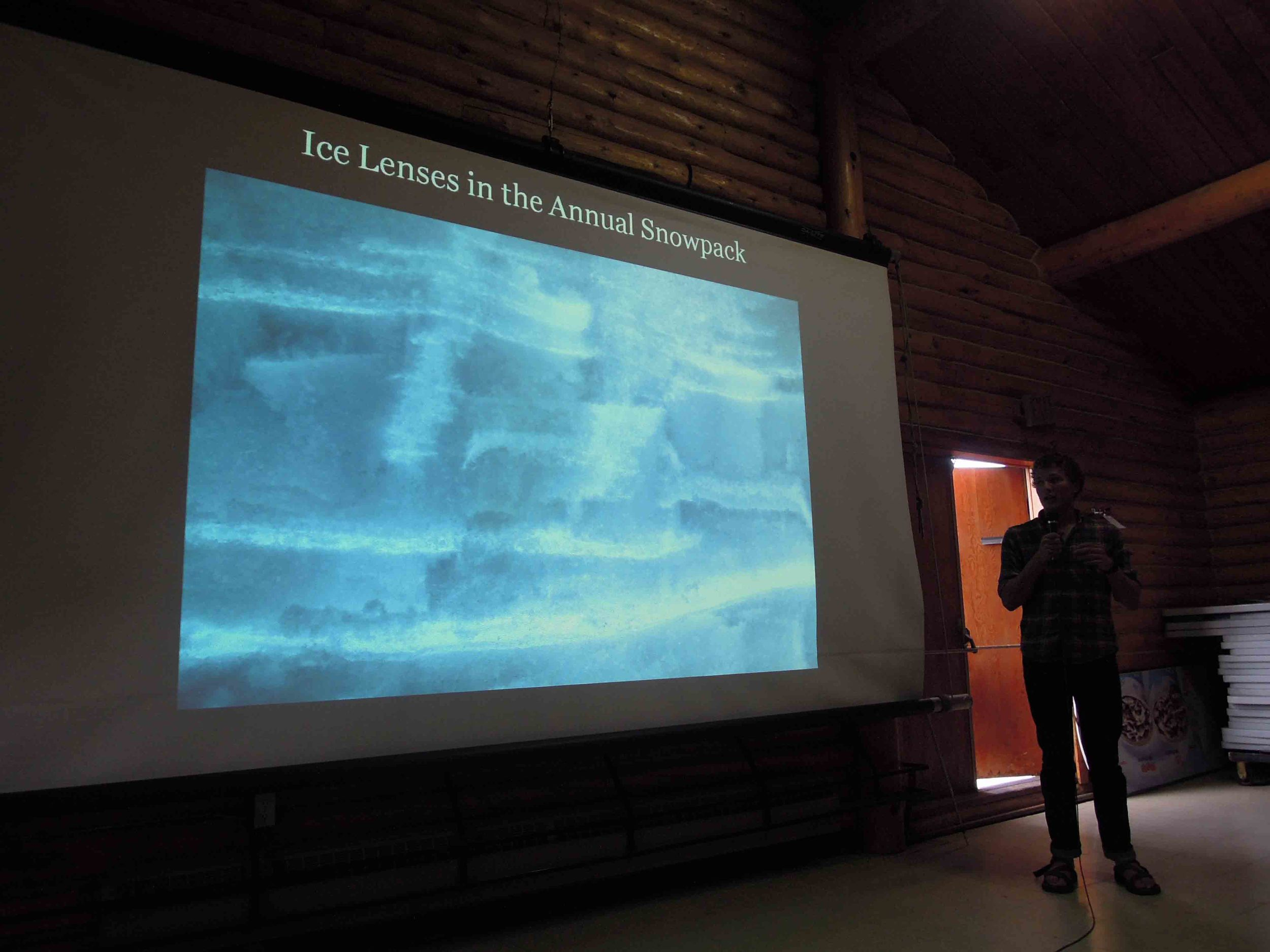 Grayson Carlile shows a picture of ice lenses. Photo by Stephanie Streich.