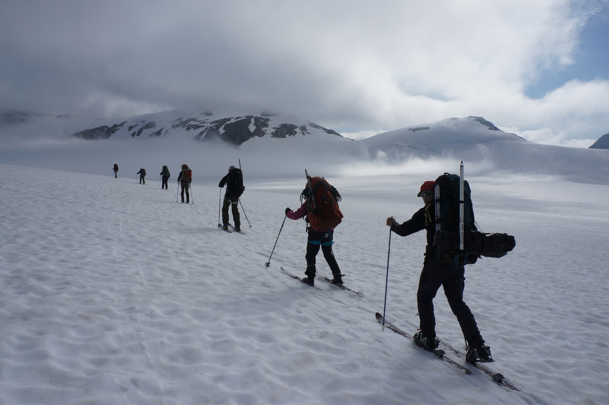 Members of trail party two begin the traverse by skiing down the Lemon Creek glacier.  photo by Alexandre Michler