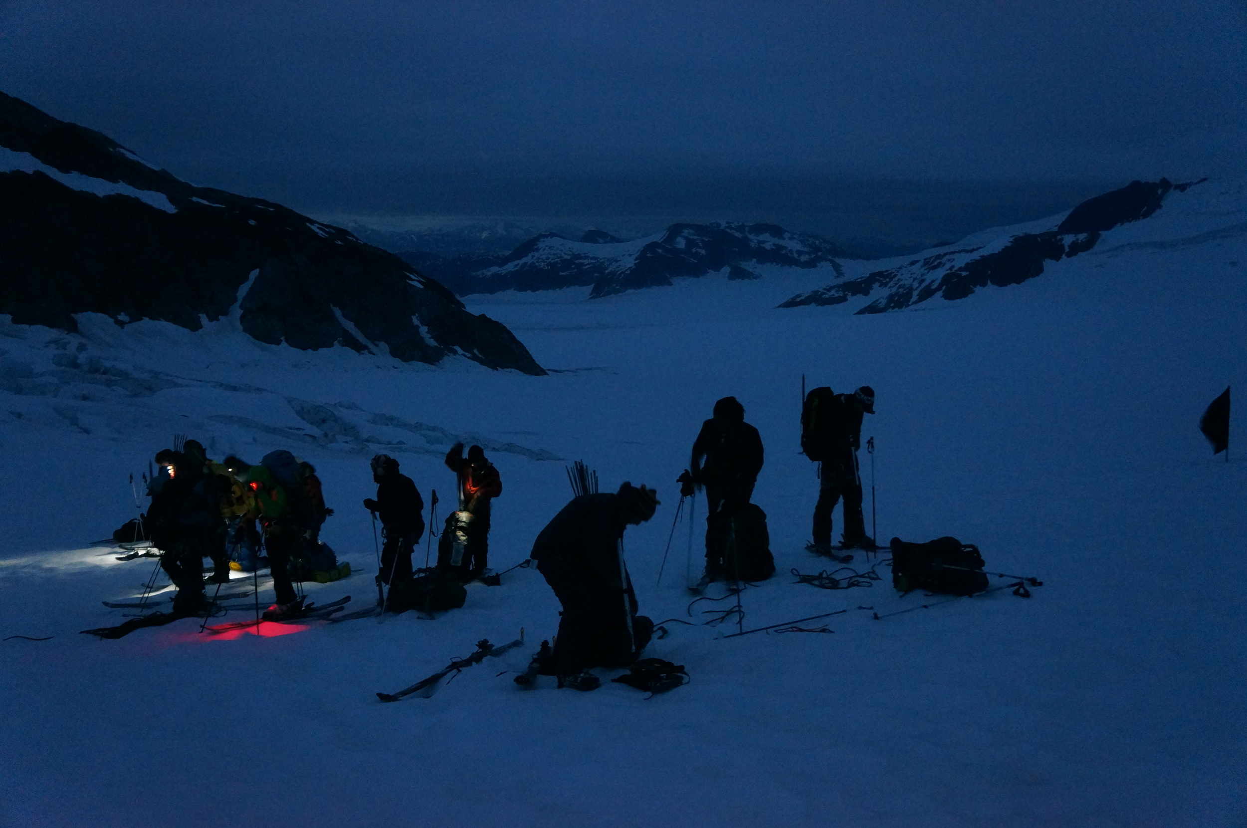 With the early summer sunrise, members of both trail parties unrope after the Norris Icefall and prepare for the final ski to find our tents at the Norris Cache. photo by Alexandre Mischler