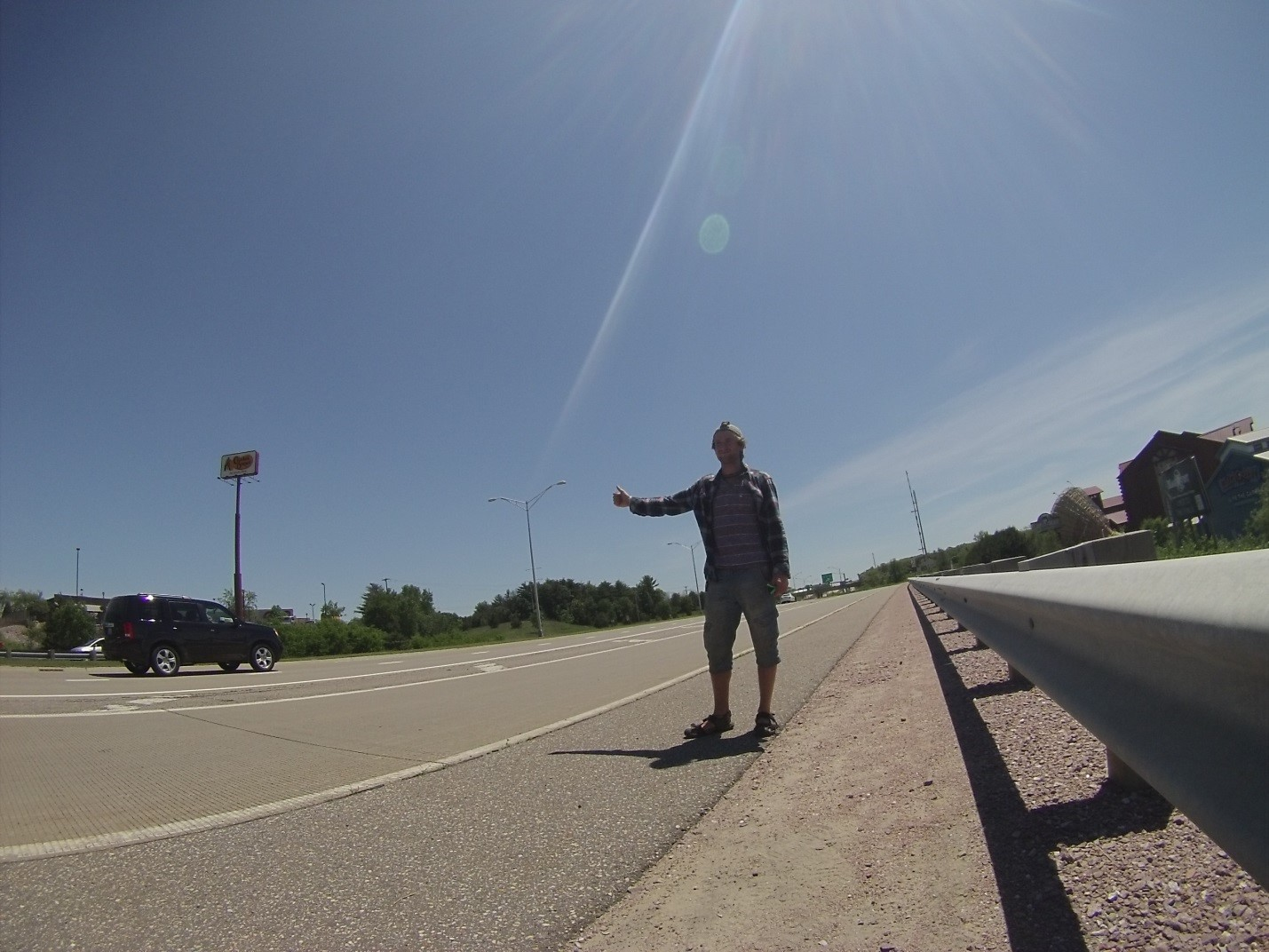 Hitchhiking in Wisconsin Dells, WI. Photo by author.
