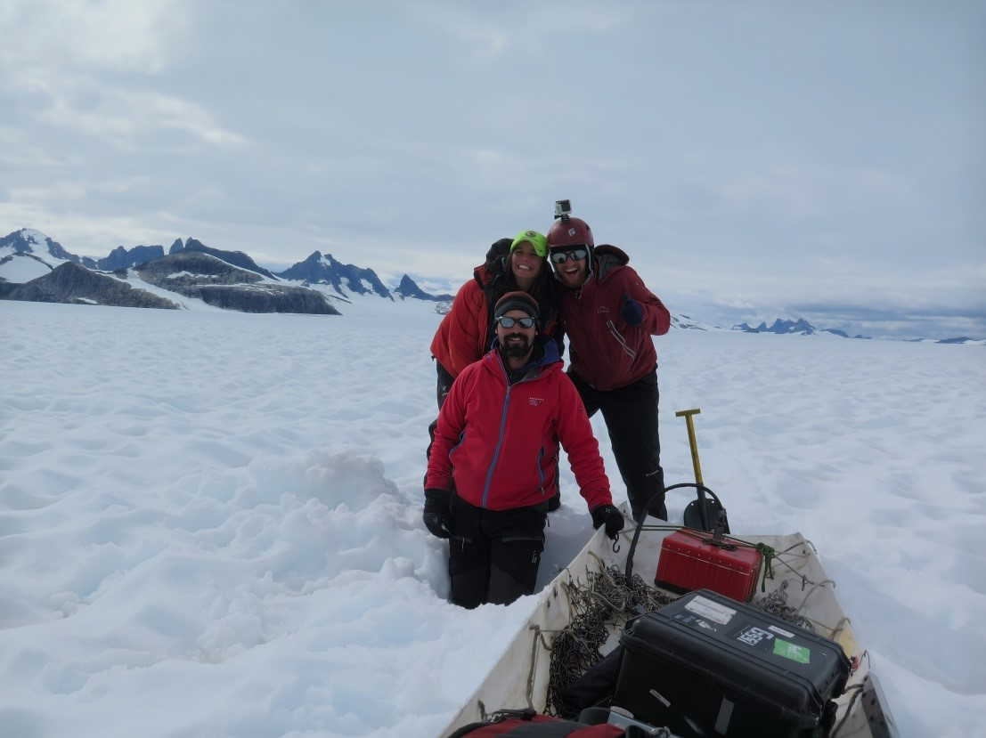Seth, Tadhg, and I having a blast dragging our GPR equipment in the old sled. (Photo by author)