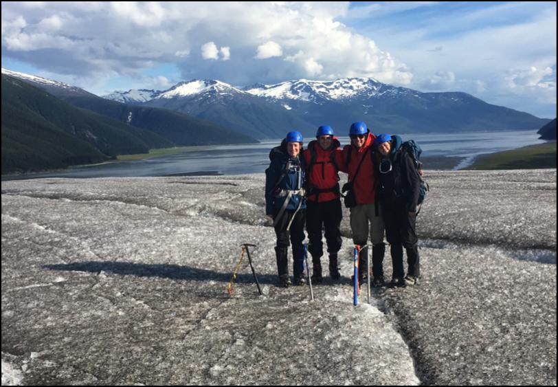 Olivia Truax, Alex Burkhart, Evan Koncewicz, and Cézy Semnacher on top of the ablation zone of the Taku Glacier.