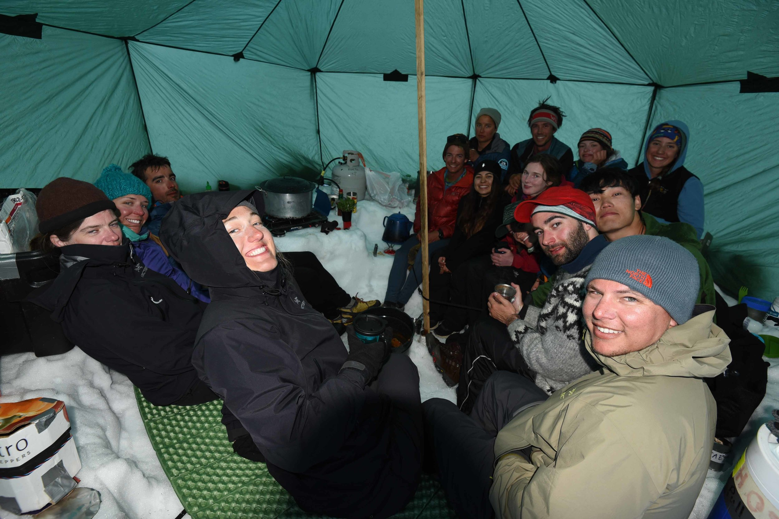 Louise enjoying a hard-won rest with fellow JIRPers at the Norris Cache, halfway through the ski traverse from Camp 17 to Camp 10. Photo courtesy PBJ Photography.