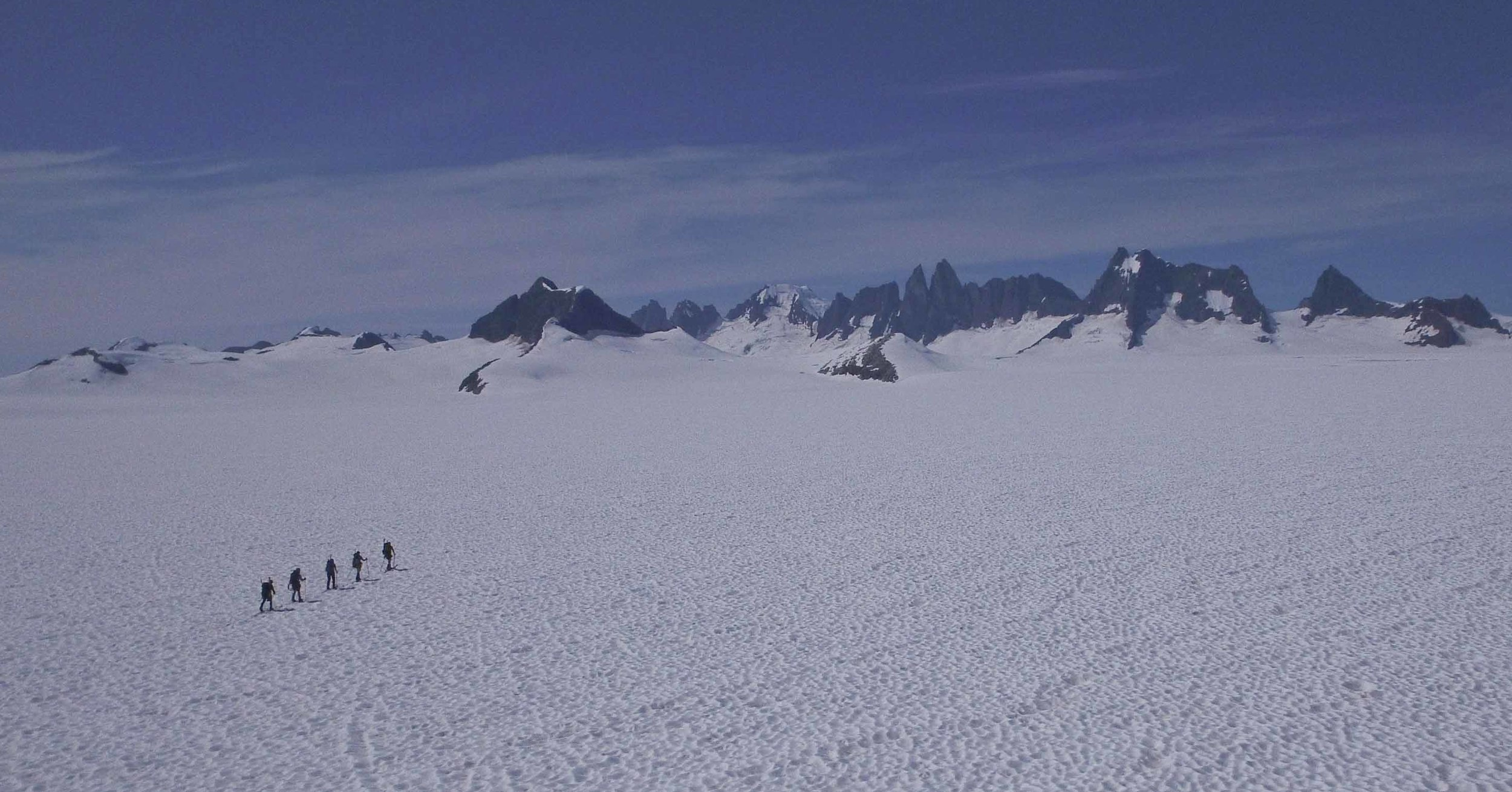 """"""". . . beneath all the ice, all nunataks are connected."""" A team of JIRPers crosses Taku Glacier. Photo by M. Beedle."""