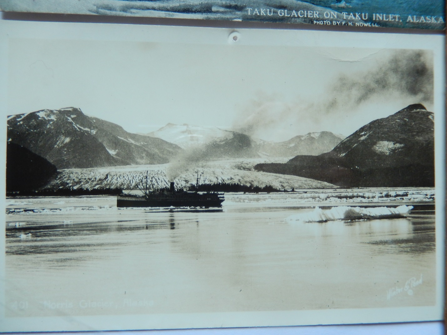 A steamship floats in front of the Taku terminus during an earlier advancement of the glacier.